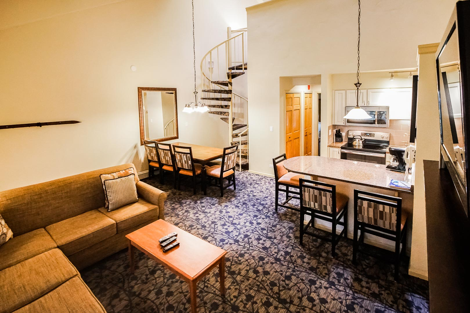 A spacious living and dining room area at VRI's Aspen at Streamside in Colorado.