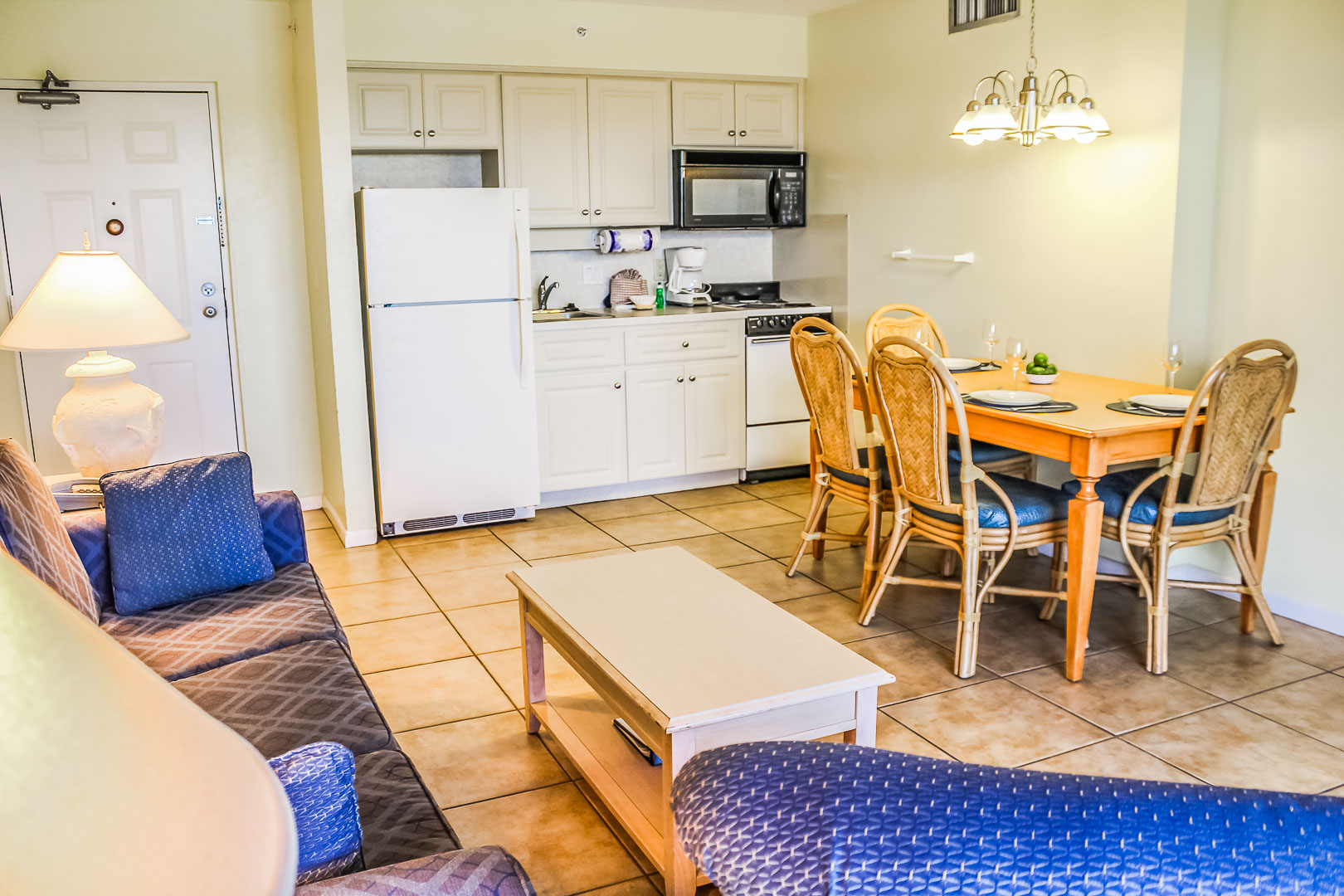 A cozy living room and partial kitchen at VRI's Bonita Resort and Club in Florida.