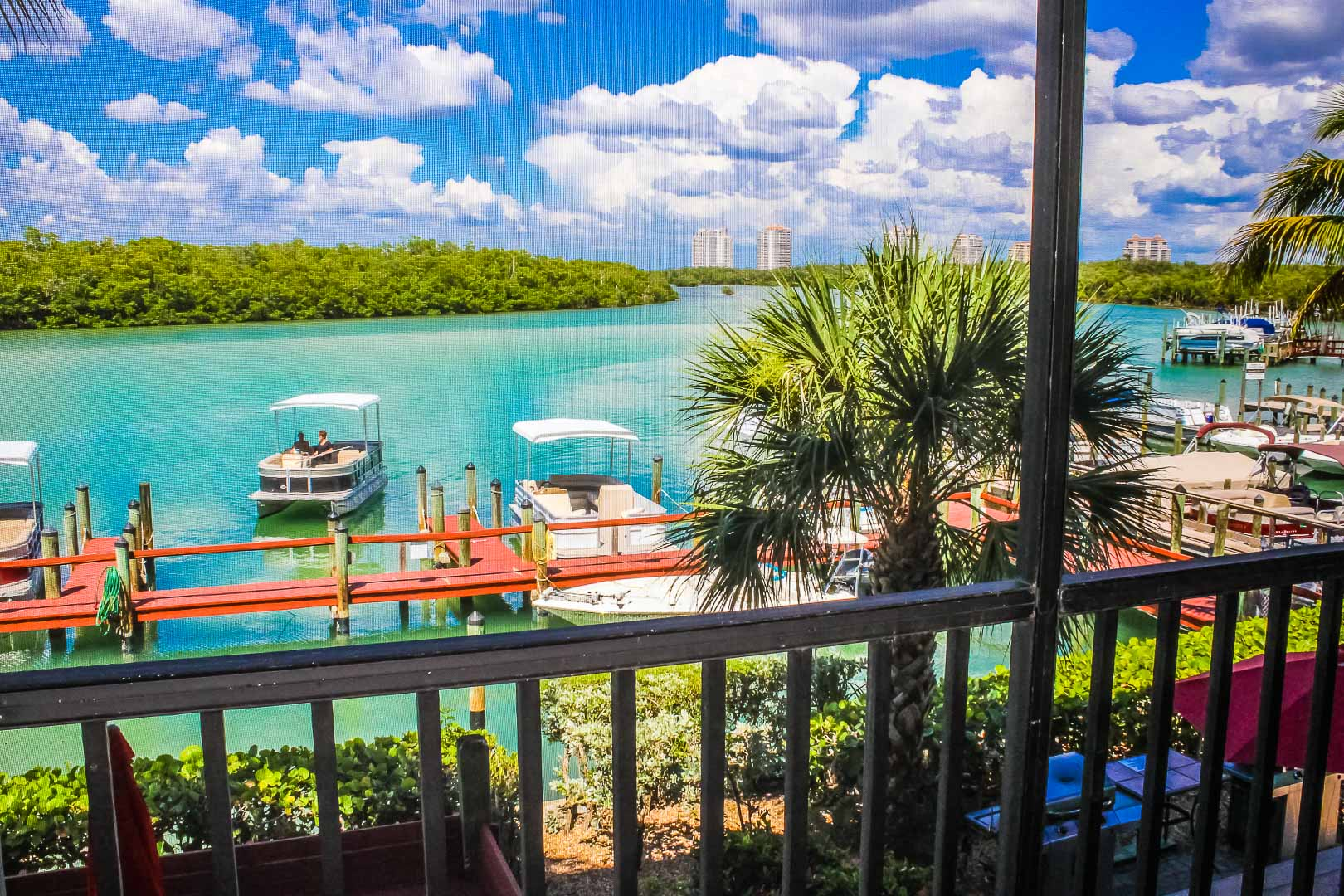A vibrant beach view from the balcony at VRI's Bonita Resort and Club in Florida.