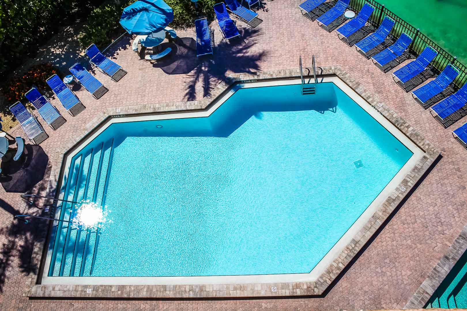 A spacious outdoor swimming pool at VRI's Bonita Resort and Club in Florida.