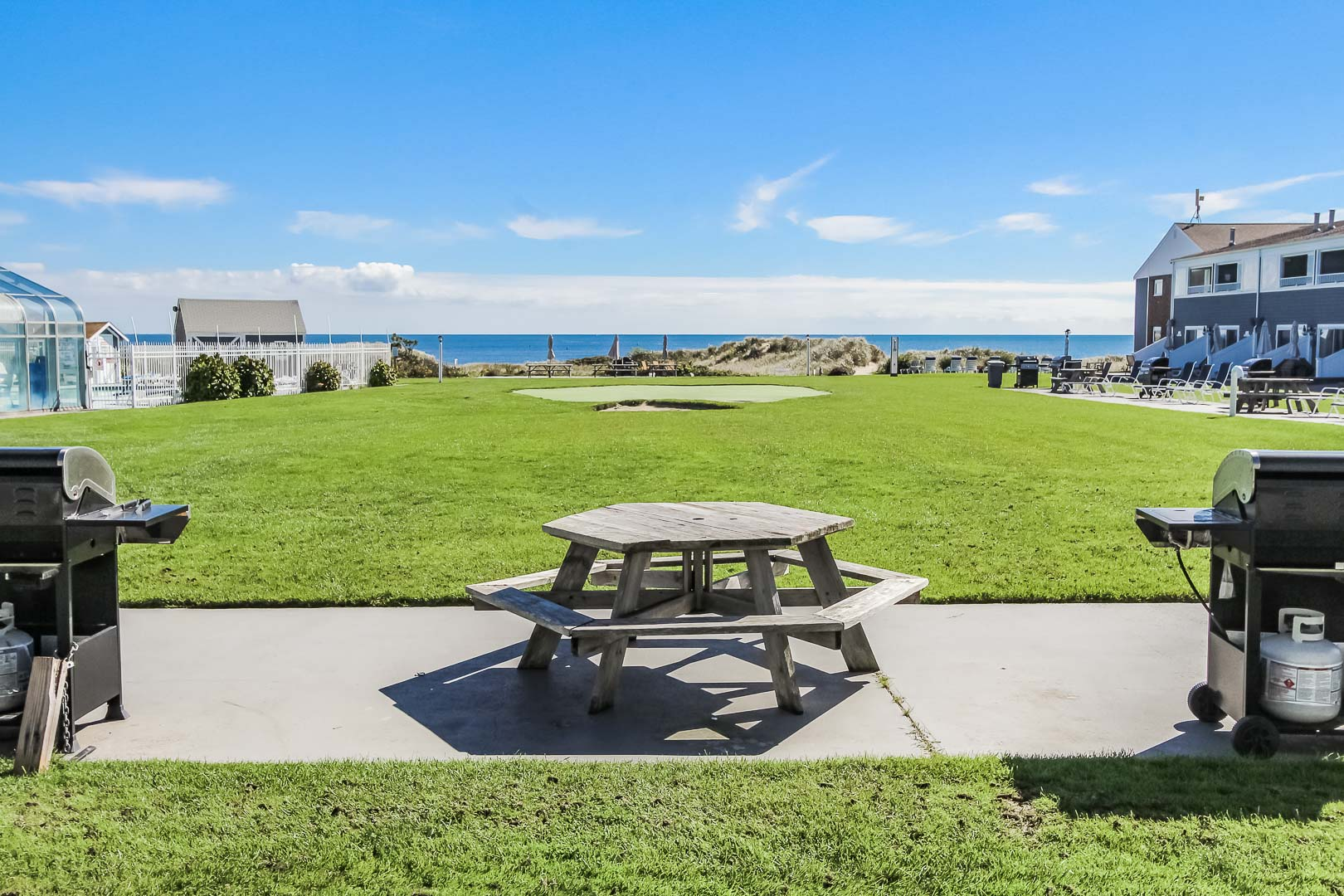 A relaxing patio deck overseeing the ocean at VRI's Edgewater Beach Resort in Massachusetts.