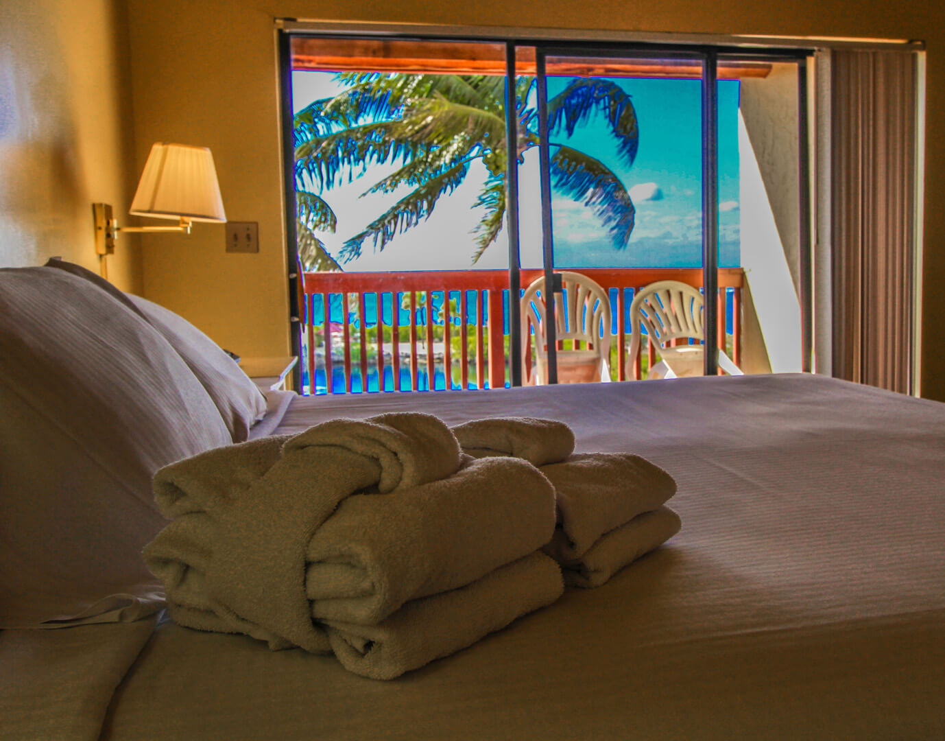 A crisp master bedroom with a balcony deck at VRI's Florida Bay Club in Florida.