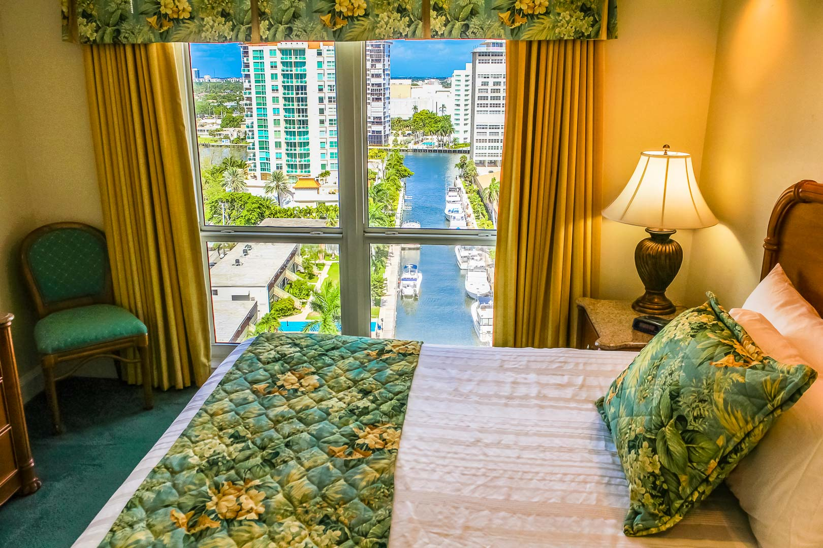 A master bedroom with a beautiful view at VRI's Ft. Lauderdale Beach Resort in Florida.