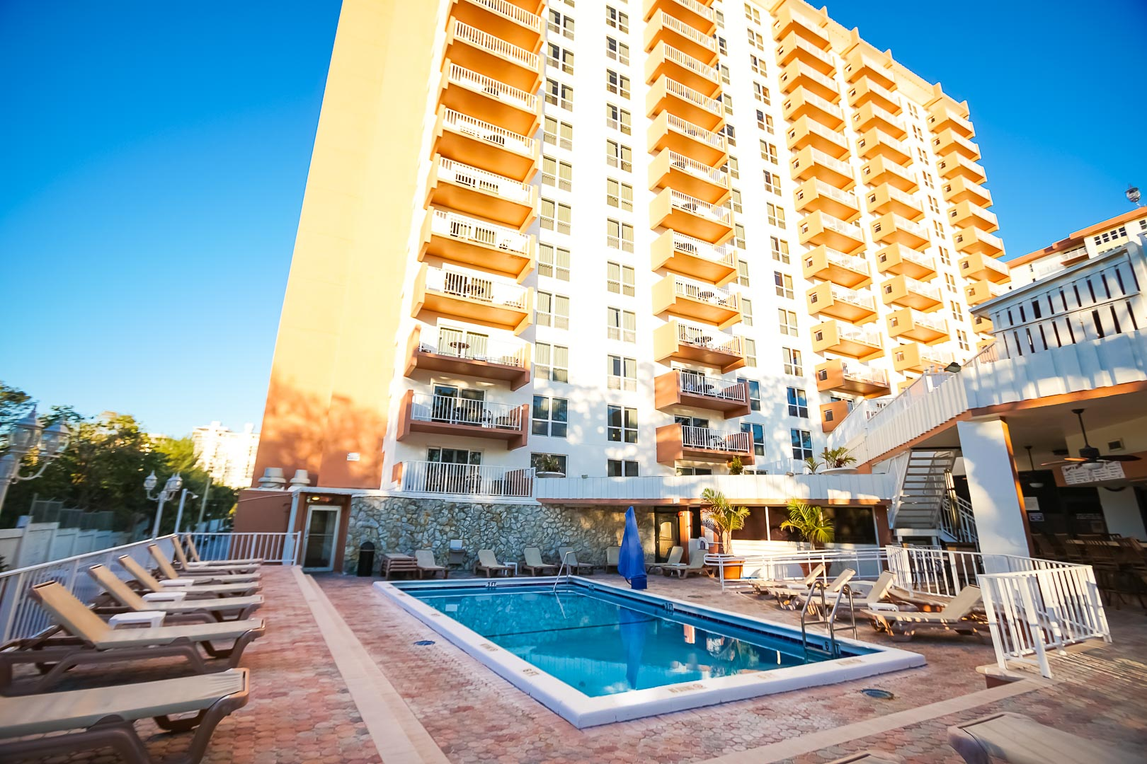 An outside view of the pool and stoic resort building at VRI's Ft. Lauderdale Beach Resort in Florida.