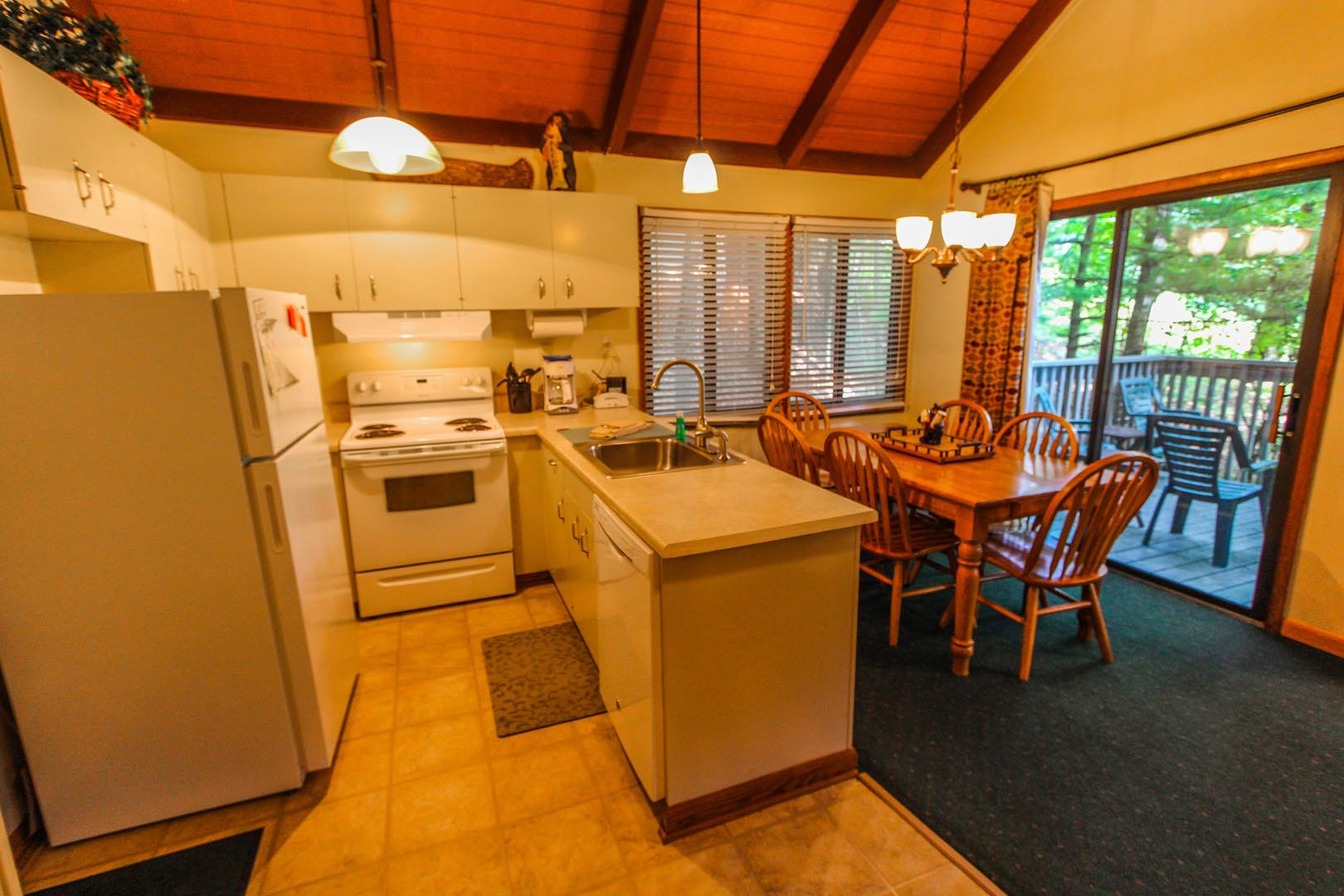 A fully equipped kitchen at VRI's Golf Club Villas in Marble Hill, Georgia.