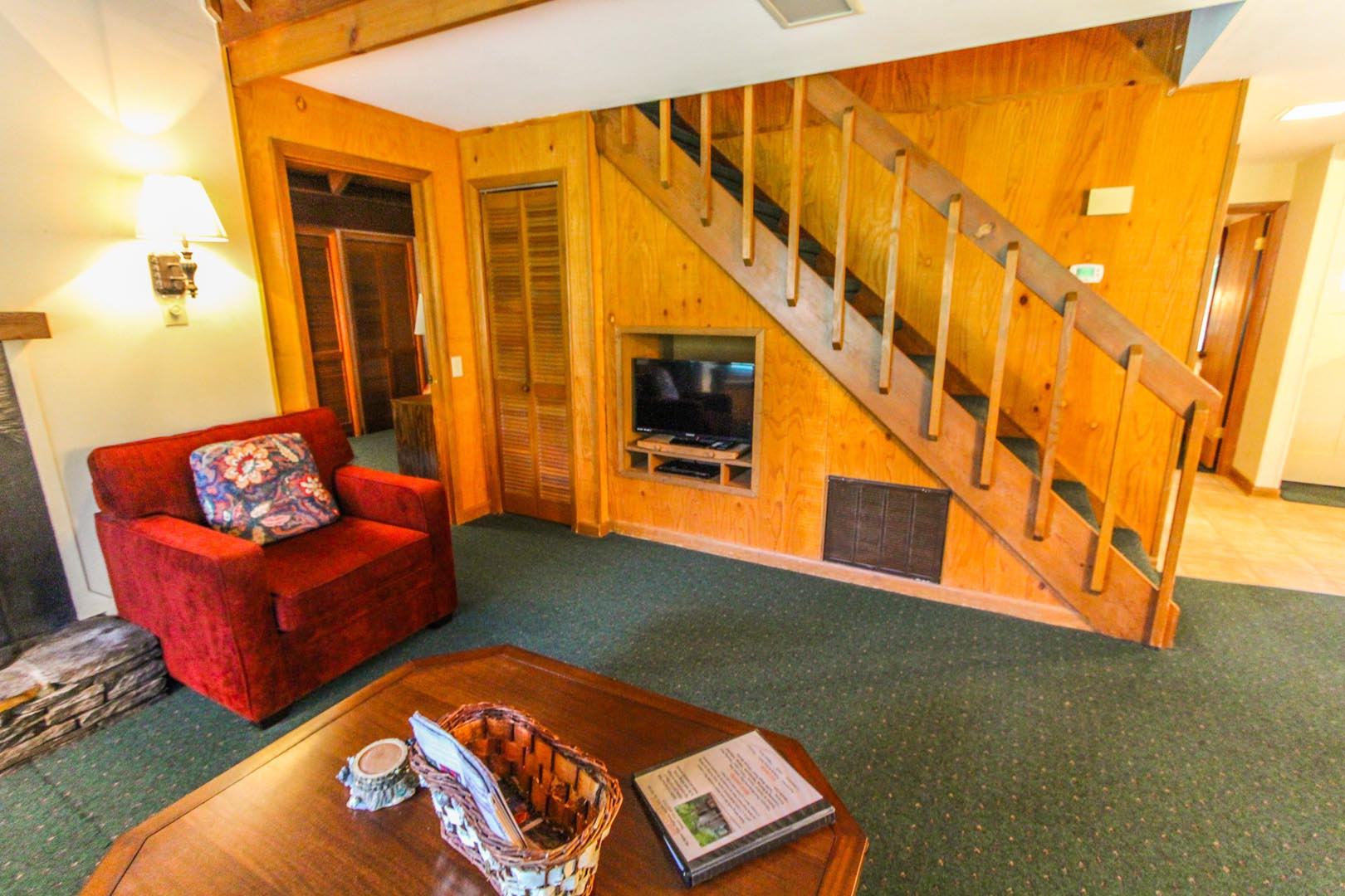 The living room and stairs to the bedrooms at VRI's Golf Club Villas in Marble Hill, Georgia.
