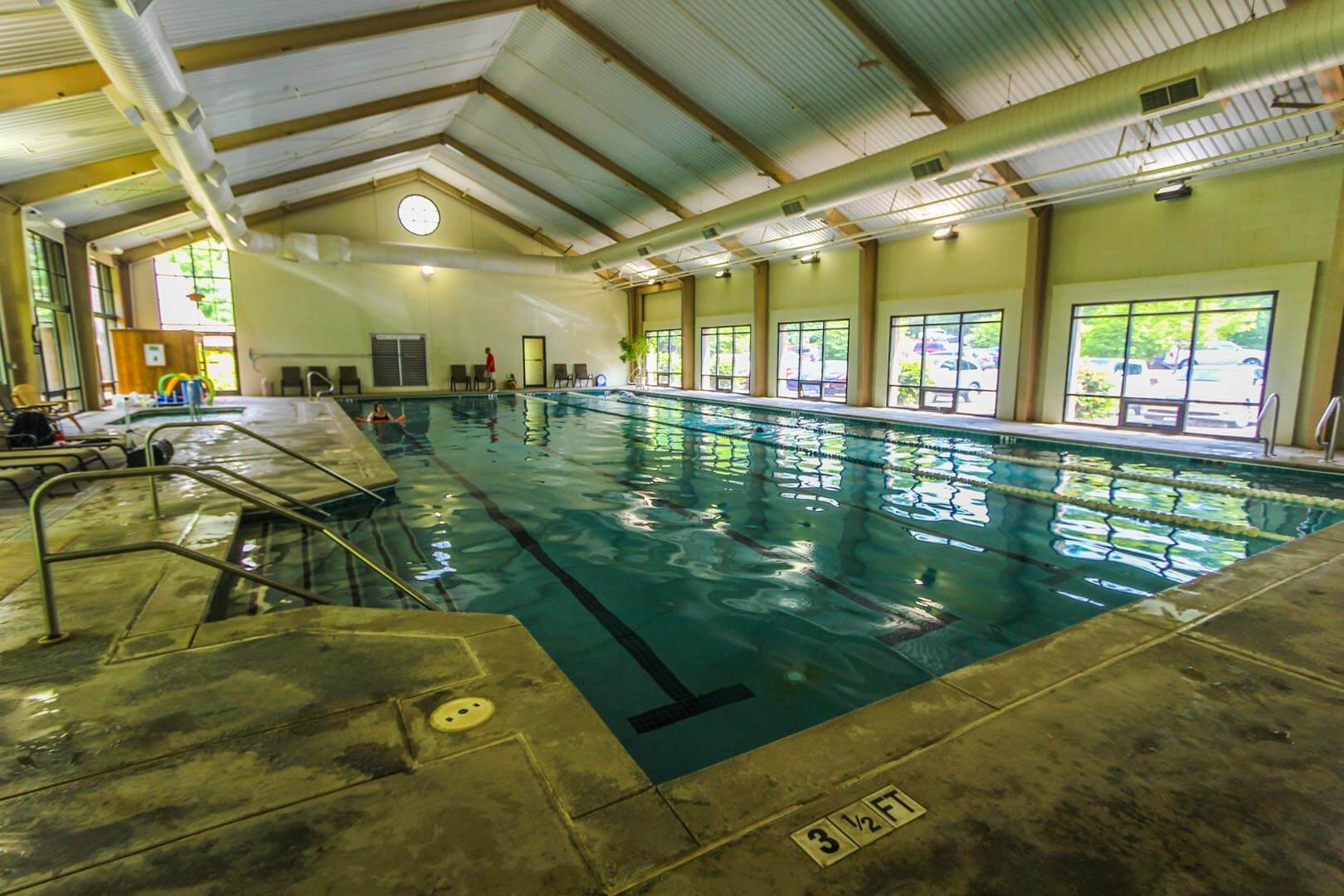 An expansive indoor swimming pool at VRI's Golf Club Villas in Marble Hill, Georgia.