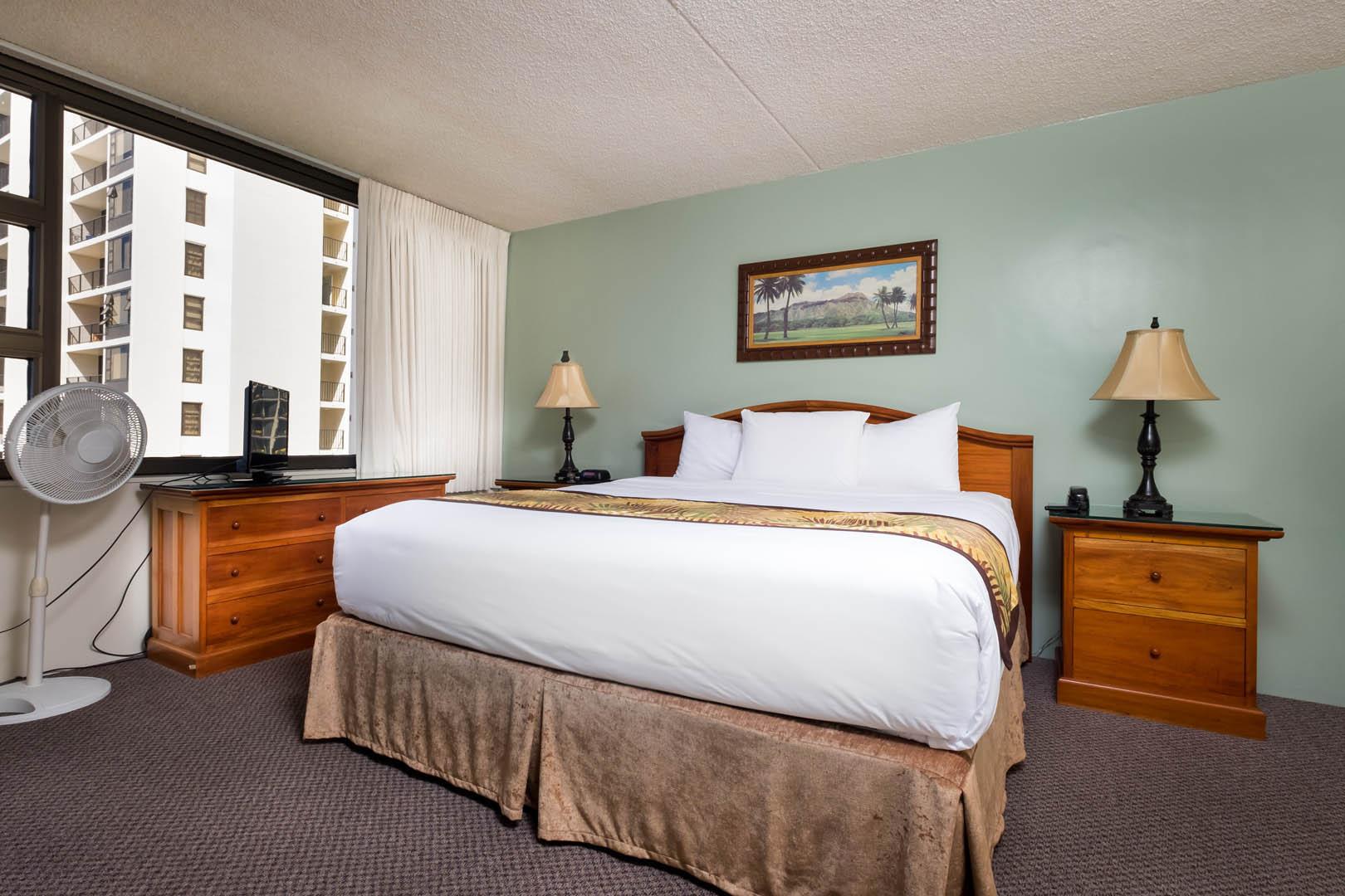 A spacious master bedroom at VRI's Hawaiian Sun Holidays in Honolulu, Hawaii.