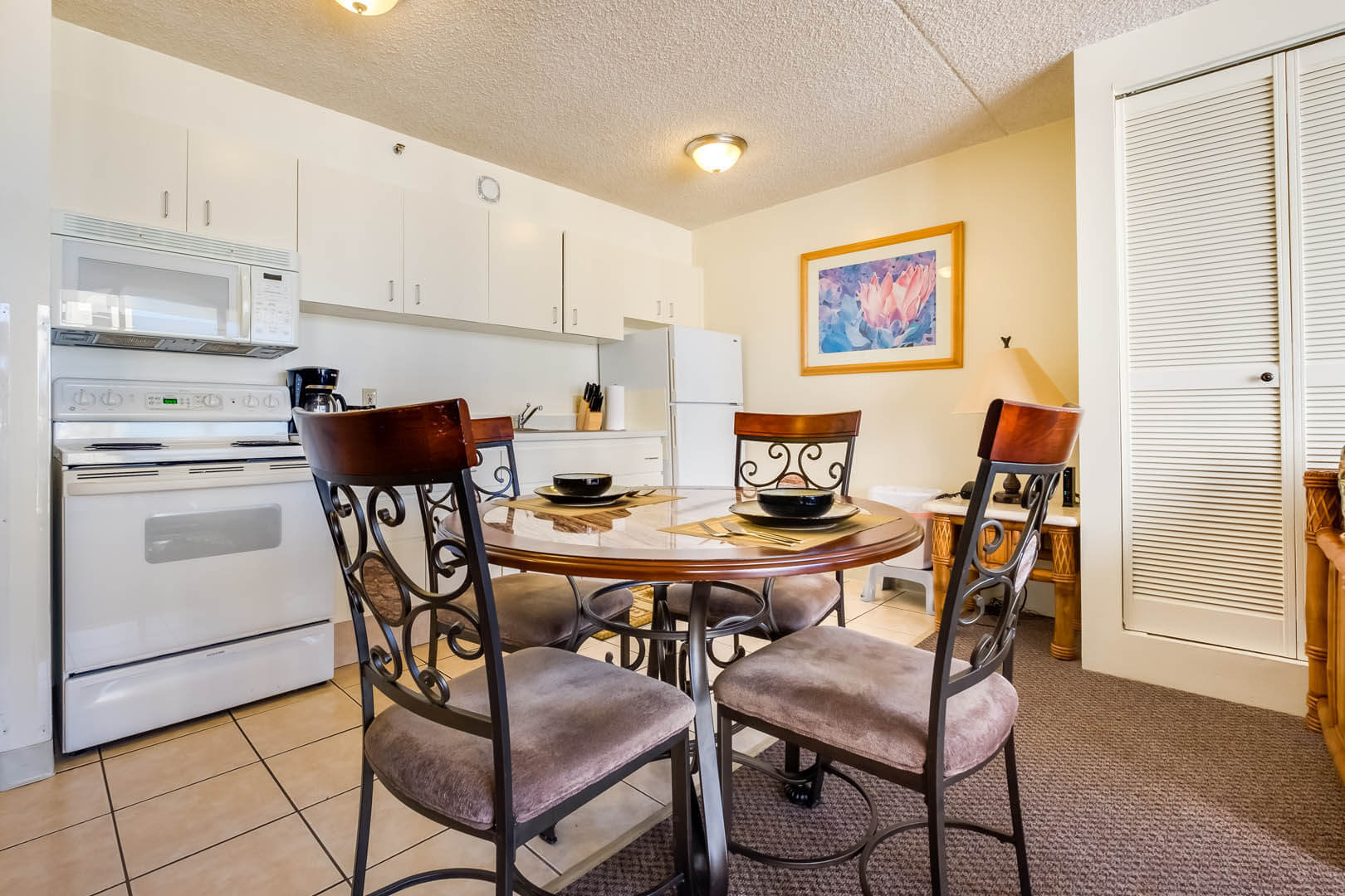 A spacious kitchen and dining table at VRI's Hawaiian Sun Holidays in Honolulu, Hawaii.