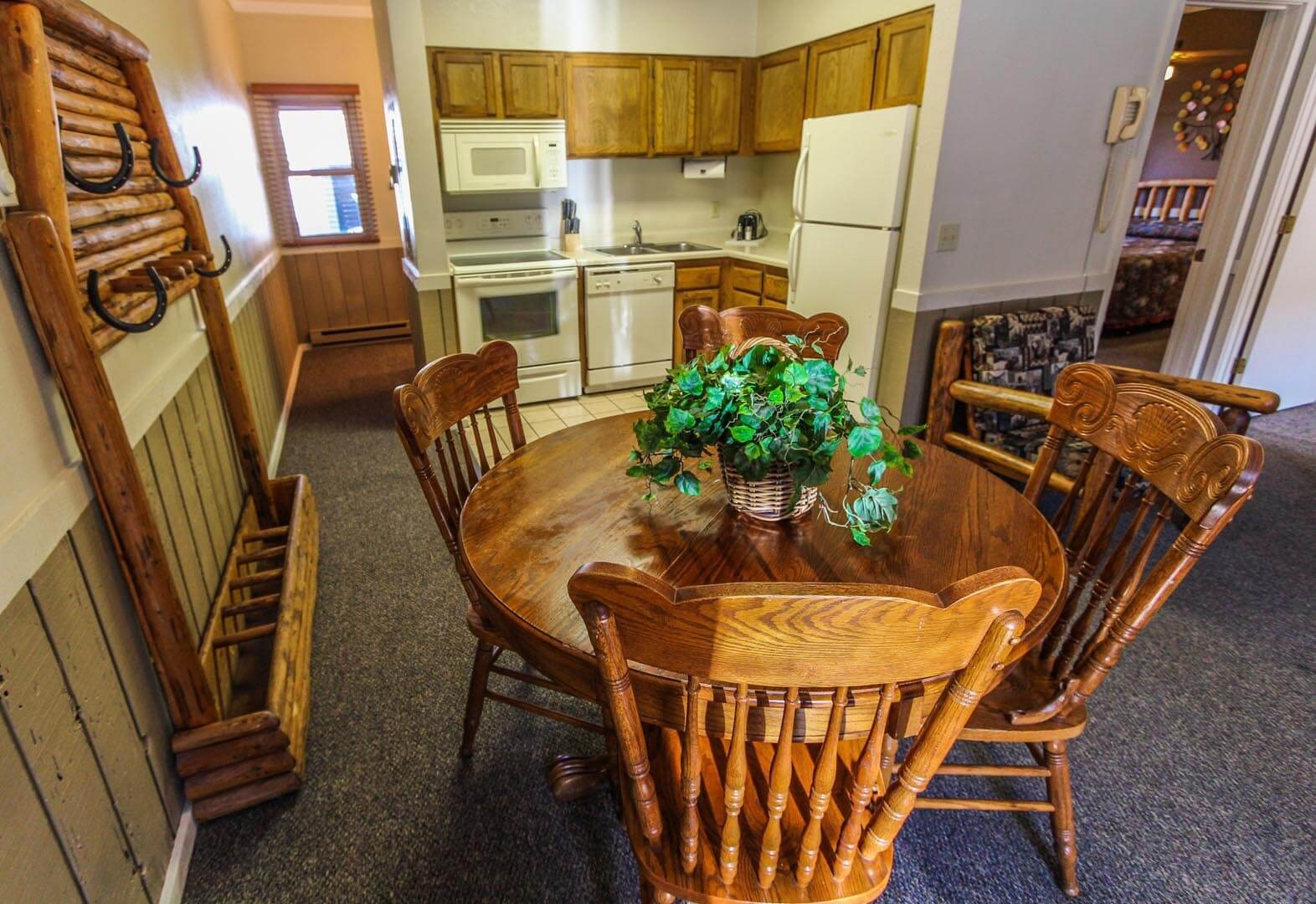 A dining room table and a full equipped kitchen at VRI's Jackson Hole Towncenter in Wyoming.