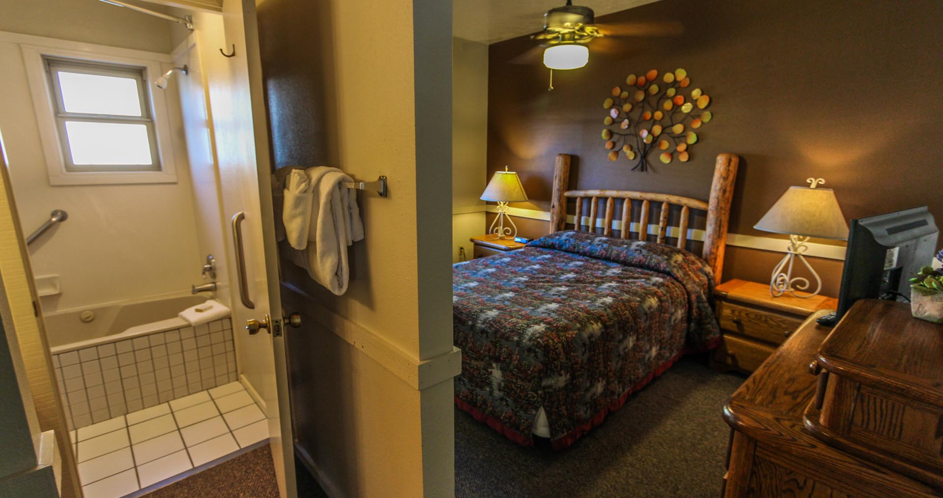 A master bedroom with bathroom at VRI's Jackson Hole Towncenter in Wyoming.