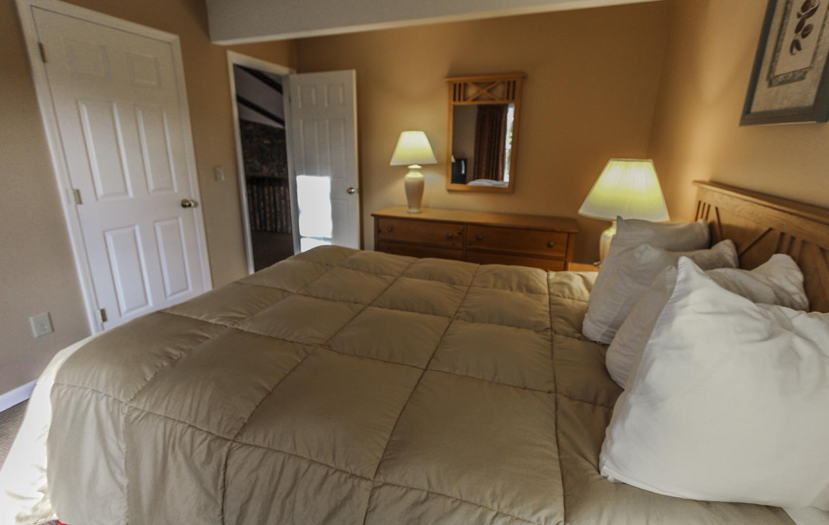 A comfy master bedroom at VRI's Lake Placid Club Lodges in New York.