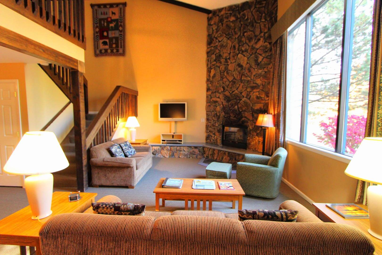 A spacious living room at VRI's Lake Placid Club Lodges in New York.
