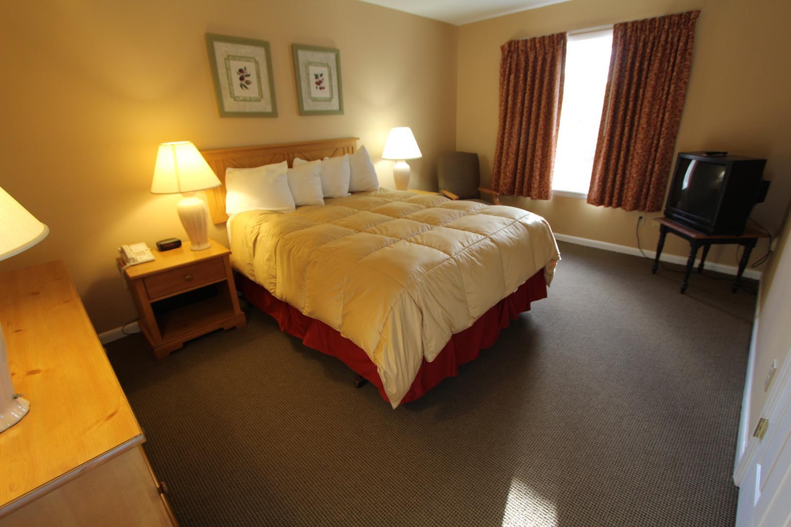 a comfy bedroom at VRI's Lake Placid Club Lodges in New York.