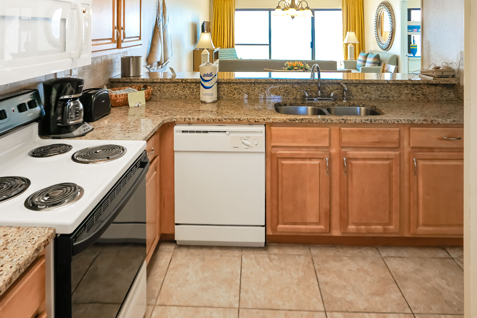 A fully equipped kitchen at VRI's Landmark Holiday Beach Resort in Panama City, Florida.