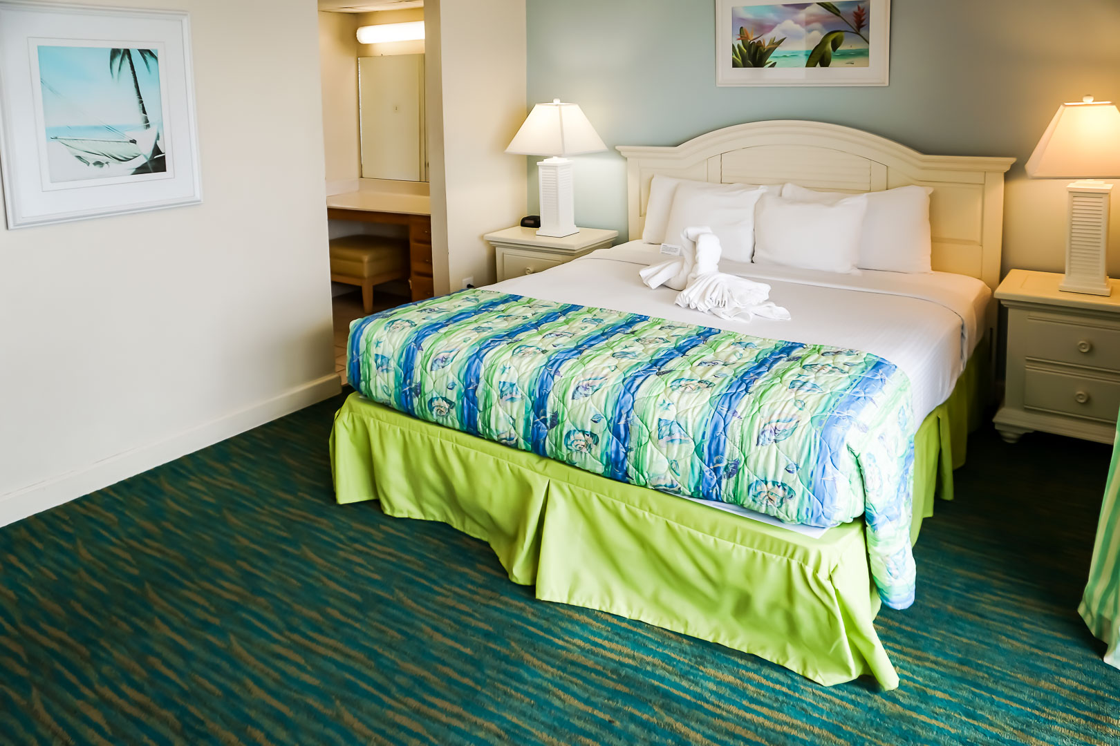 A vibrant master bedroom at VRI's Landmark Holiday Beach Resort in Panama City, Florida.