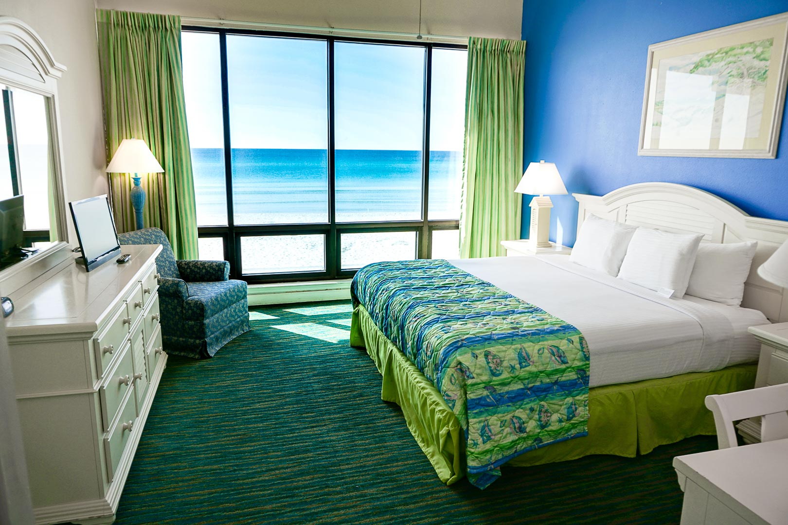 A beautiful master bedroom with a view to the beach at VRI's Landmark Holiday Beach Resort in Panama City, Florida.