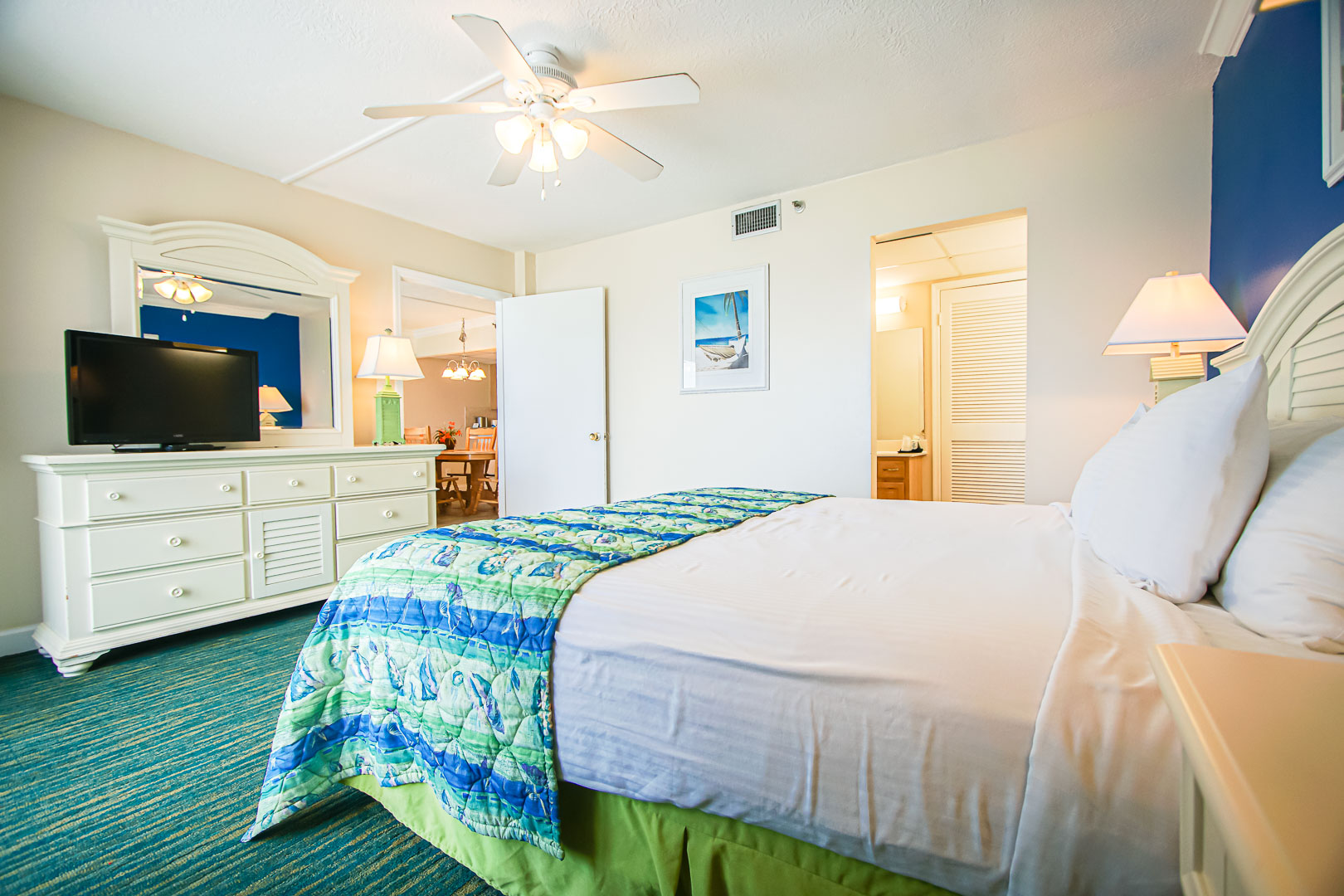 An airy master bedroom at VRI's Landmark Holiday Beach Resort in Panama City, Florida.