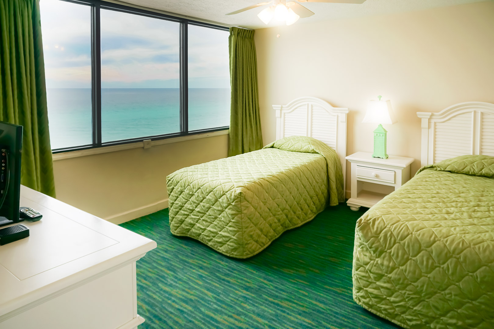 A two bedroom unit with double beds at VRI's Landmark Holiday Beach Resort in Panama City, Florida.
