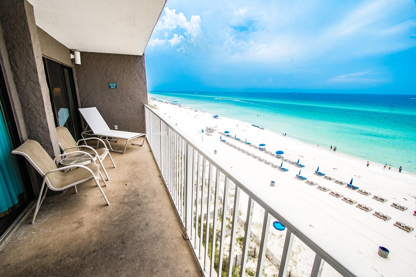 A relaxing view of the beach from the balcony at VRI's Landmark Holiday Beach Resort in Panama City, Florida.