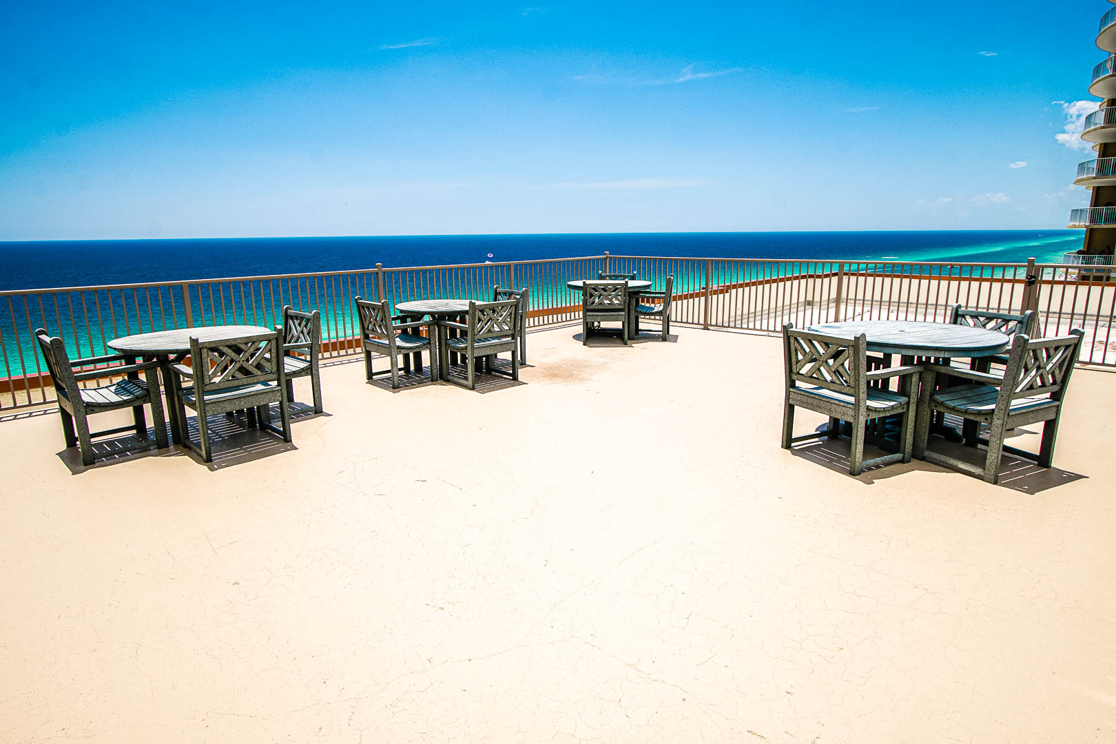 A spacious patio facing the beach at VRI's Landmark Holiday Beach Resort in Panama City, Florida.