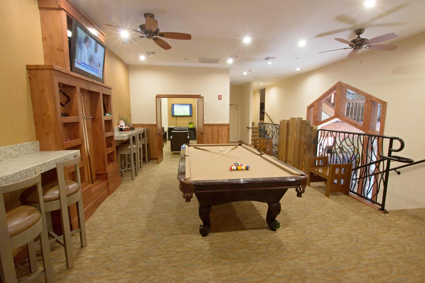 An expansive lobby area with a pool table section at VRI's Mountain Retreat Resort in California.