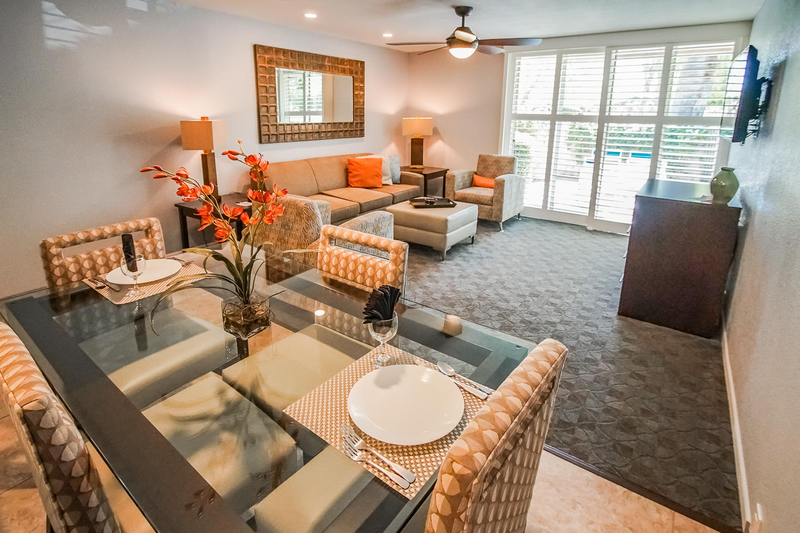A modern living and dining room area at VRI's Palm Springs Tennis Club in California.