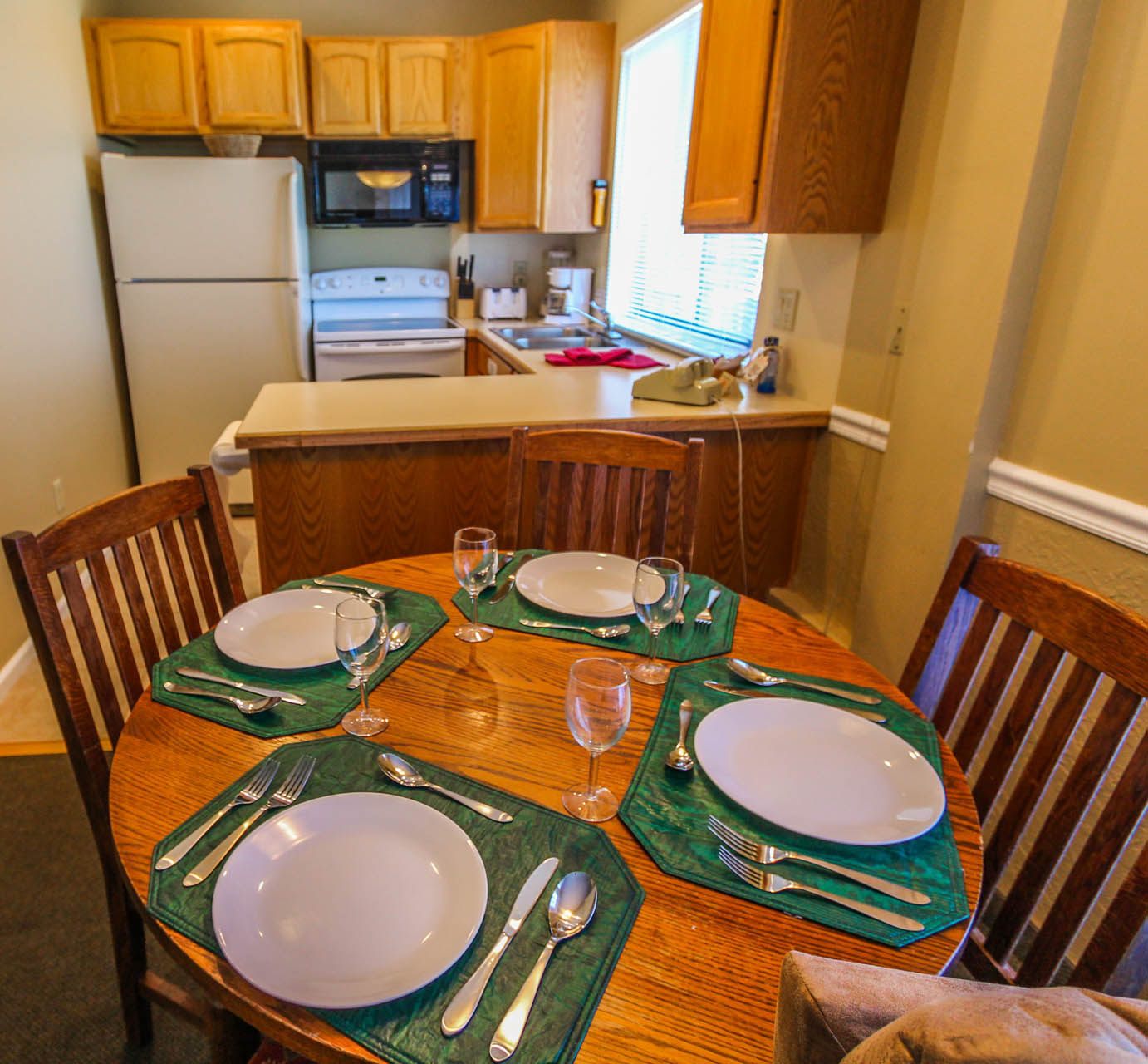 A fully equipped kitchen and dining room at VRI's Powder Ridge Village in Eden, Utah.