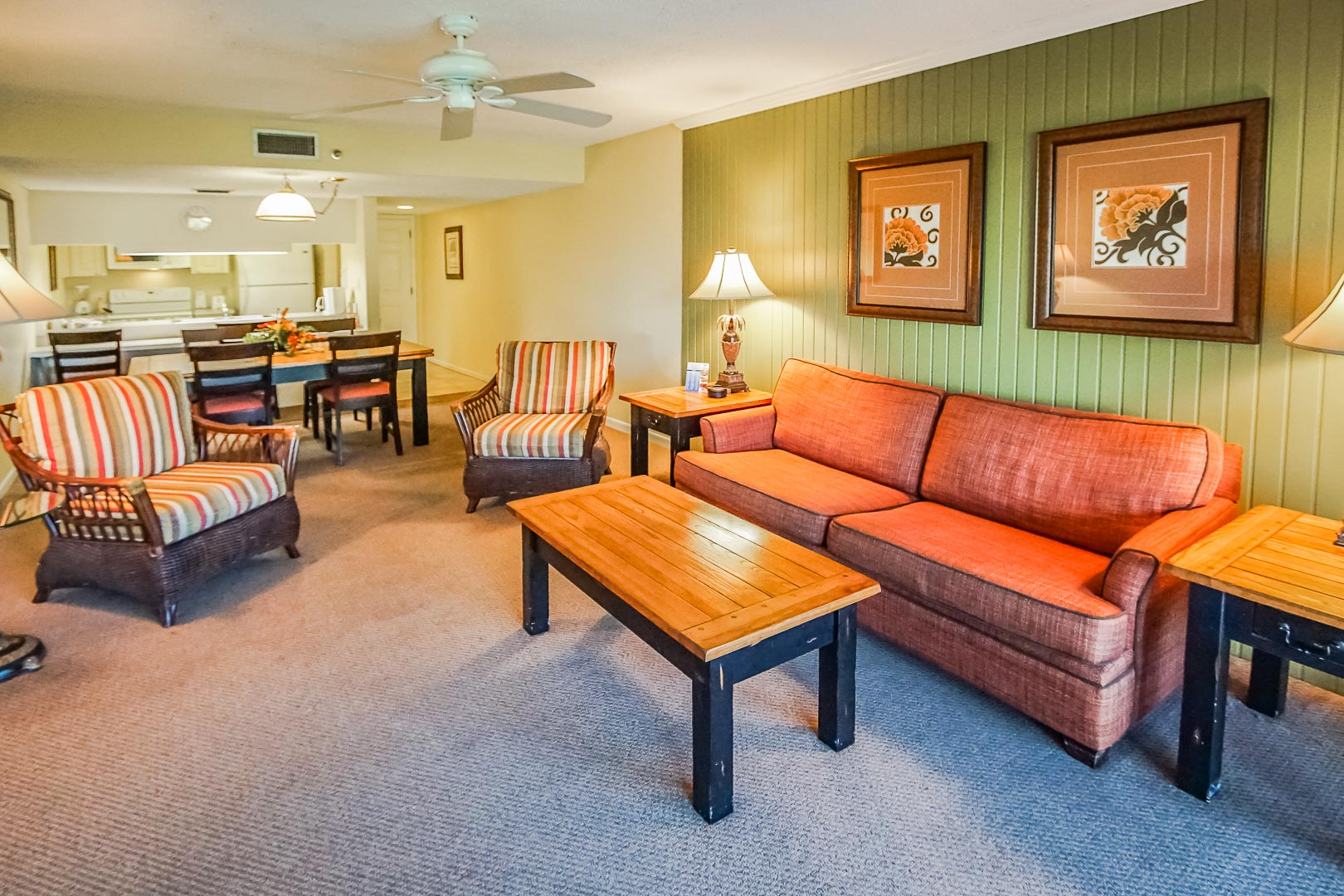 A spacious living room and dining room at VRI's Sand Pebble Resort in Treasure Island, Florida.