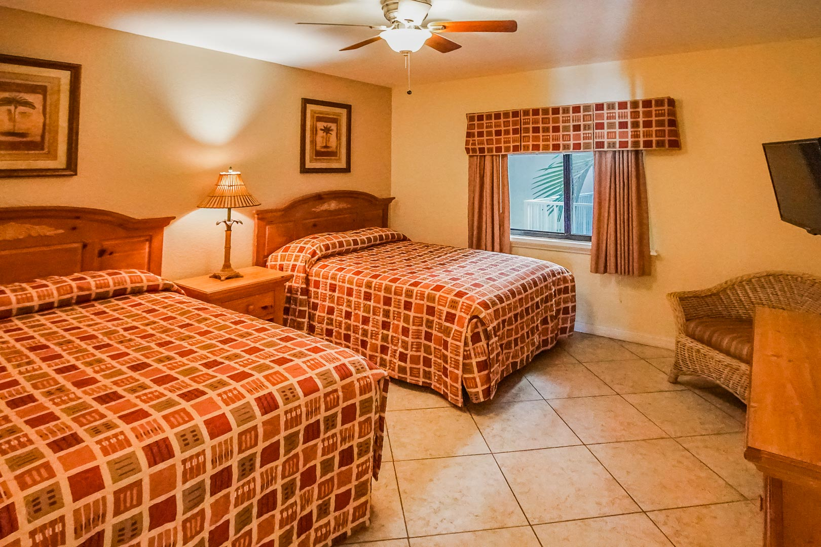 A bedroom with double beds at VRI's Sand Pebble Resort in Treasure Island, Florida.