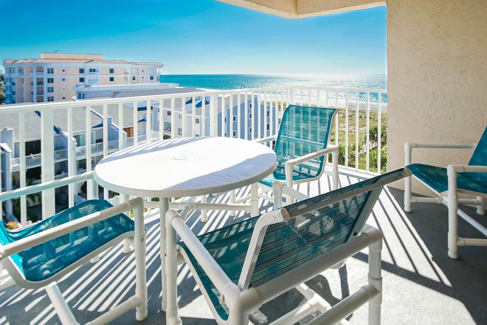 A balcony with an ocean view at VRI's Sand Pebble Resort in Treasure Island, Florida.