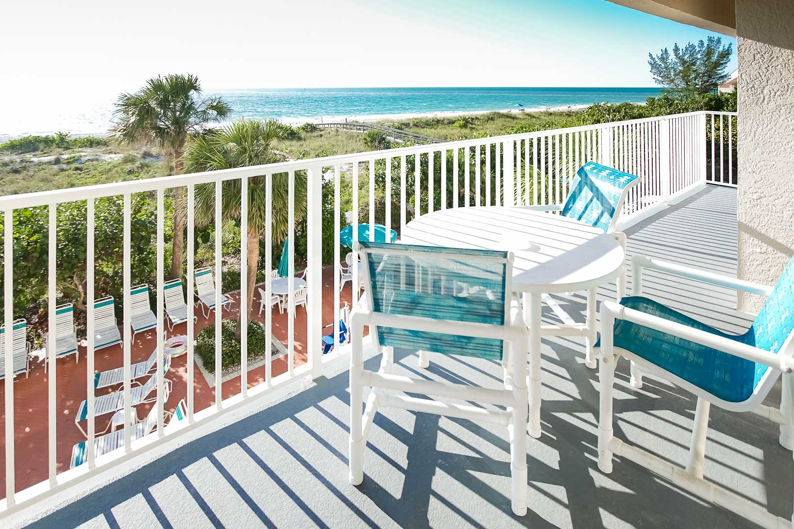 An expansive balcony with an ocean view at VRI's Sand Pebble Resort in Treasure Island, Florida.