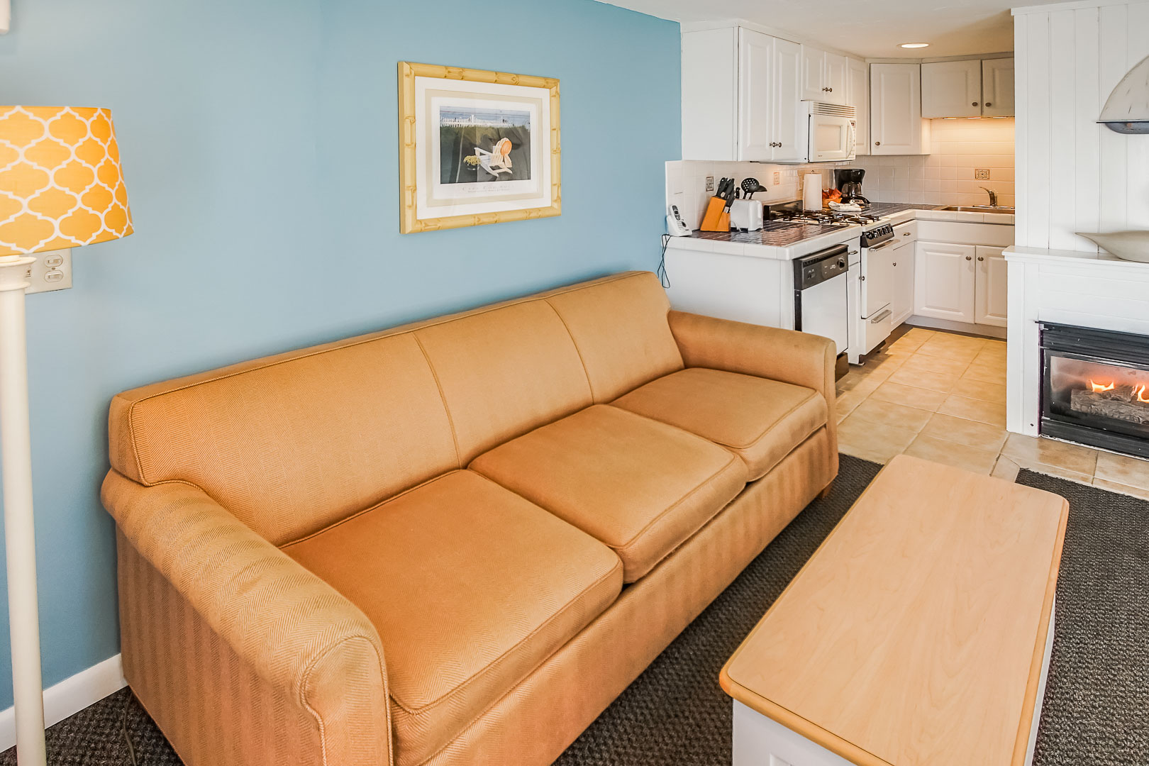 A cozy living room area and kitchen at VRI's Seawinds II Resort in Massachusetts.