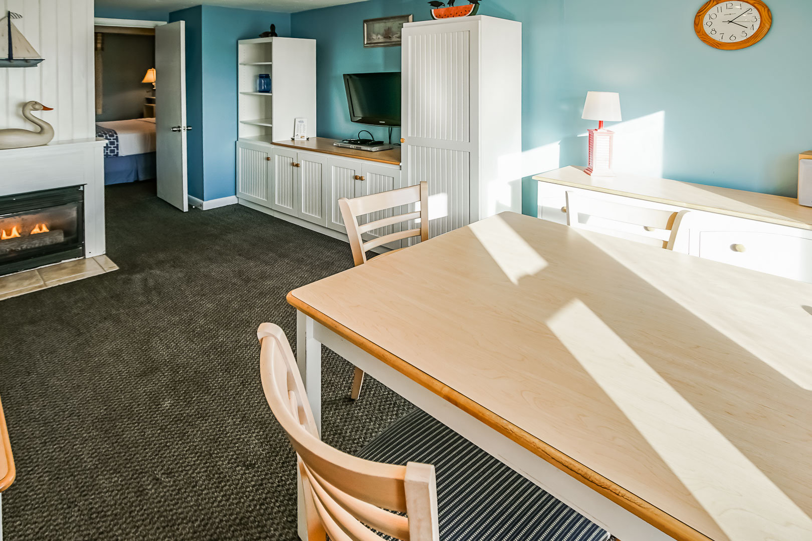 A cozy living room and dining room area at VRI's Seawinds II Resort in Massachusetts.