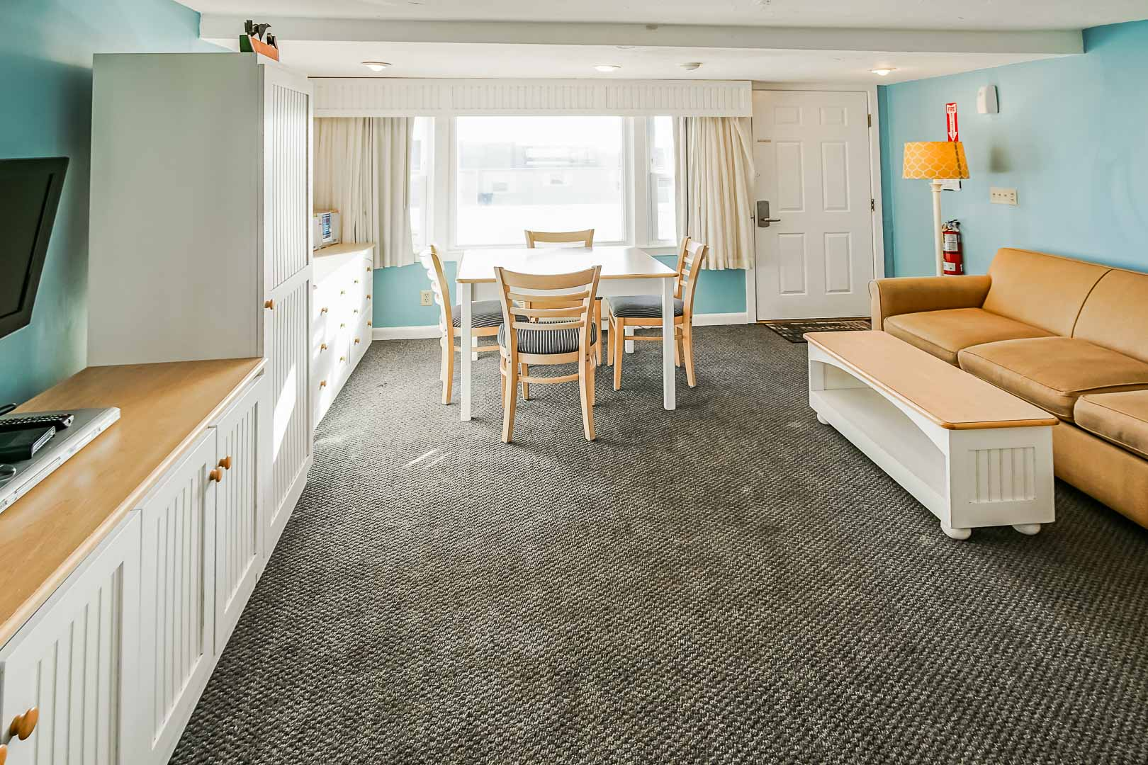 A standard dining and living room area at VRI's Seawinds II Resort in Massachusetts.