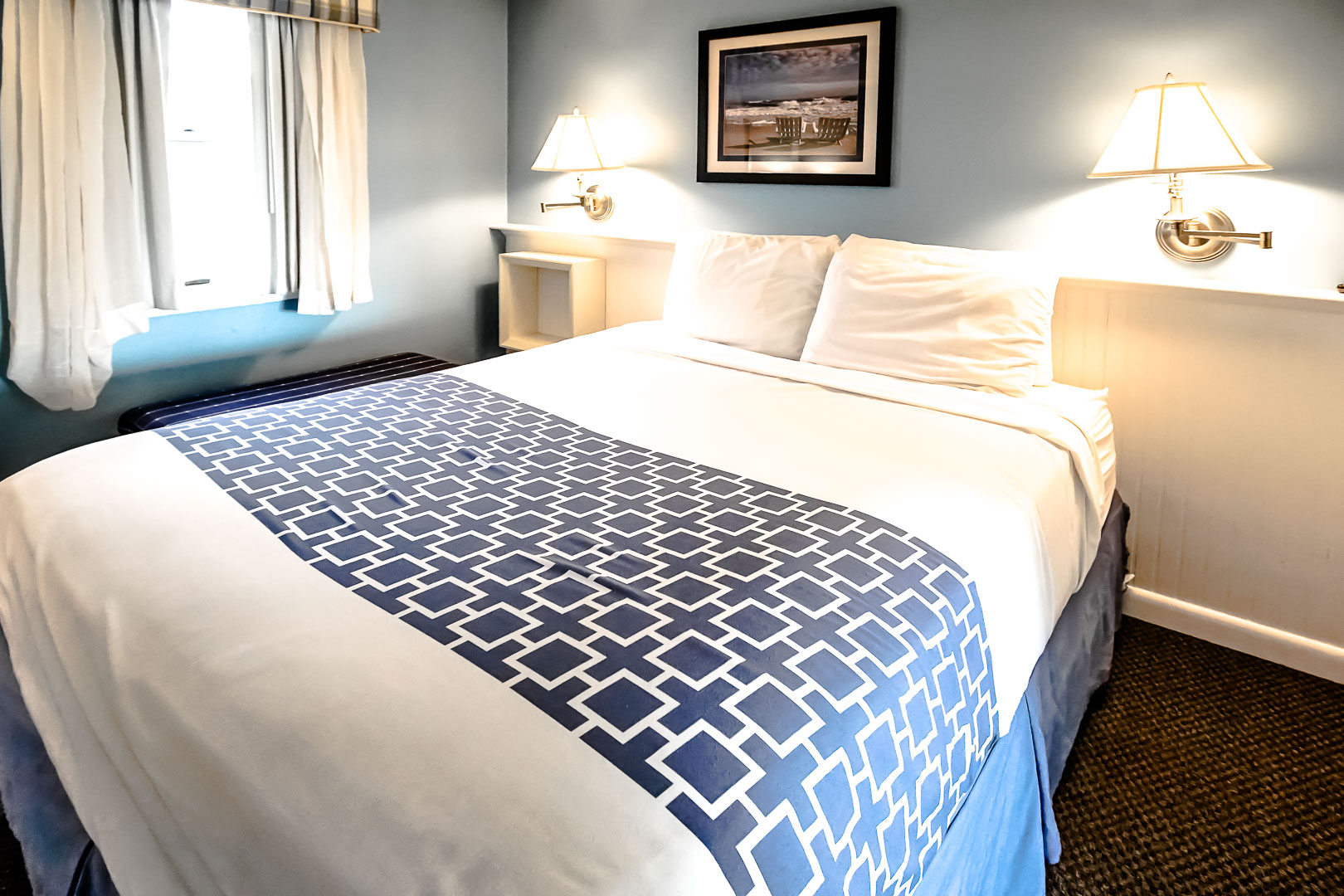 A crisp and clean master bedroom with a king size bed at VRI's Seawinds II Resort in Massachusetts.