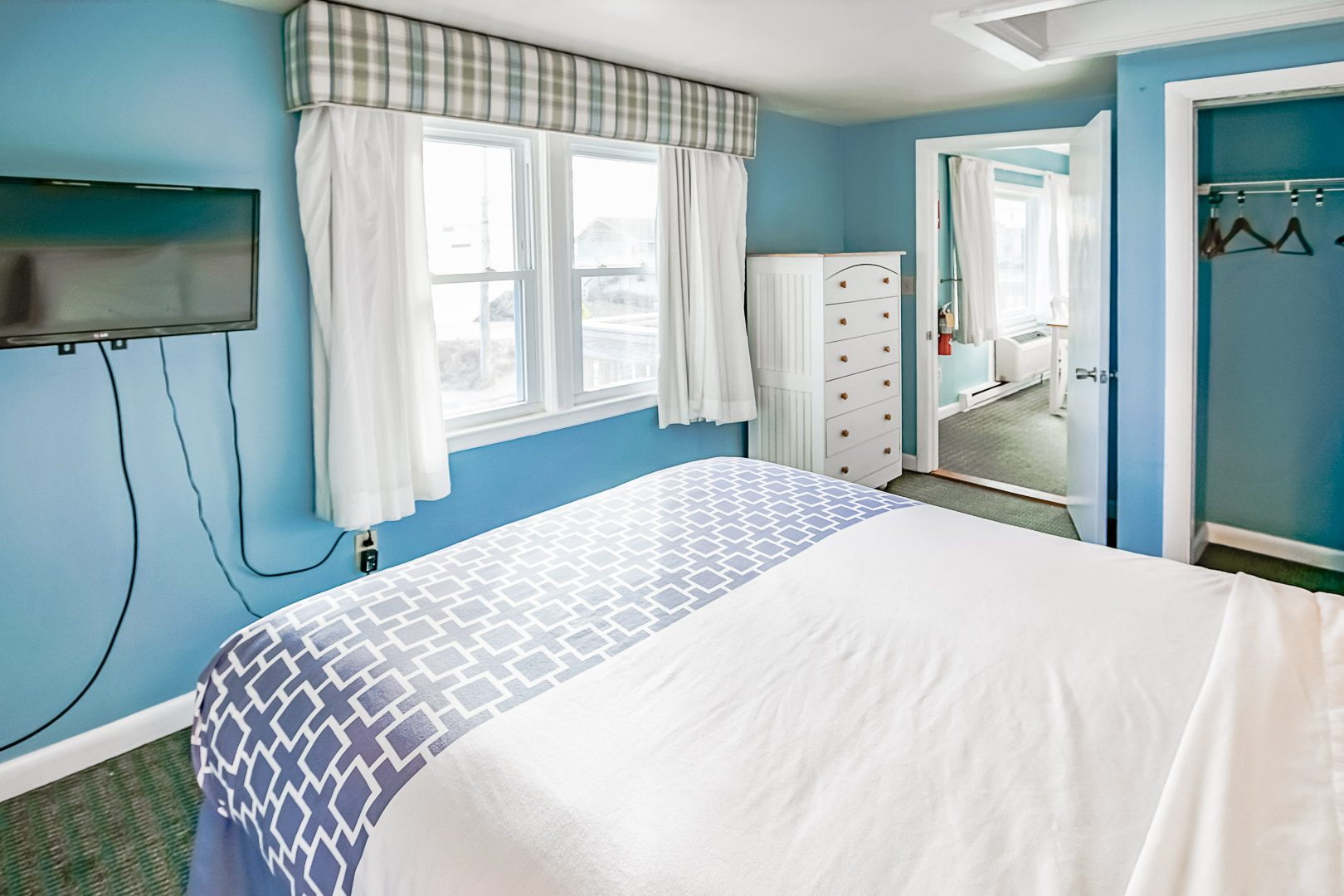 A vibrant master bedroom at VRI's Seawinds II Resort in Massachusetts.