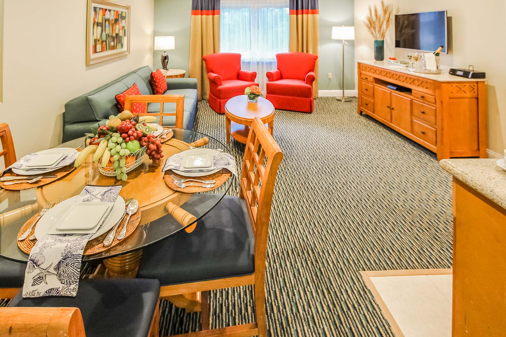Fully equipped dining and living room area at VRI's The Cove at Yarmouth in Massachusetts.