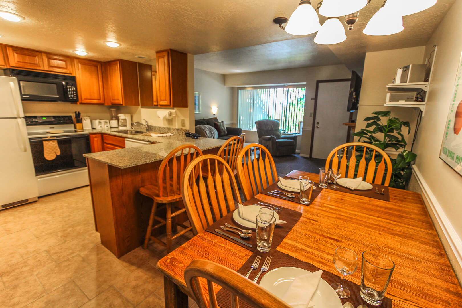A spacious kitchen and dining room table at VRI's Wolf Creek Village I in Eden, Utah.