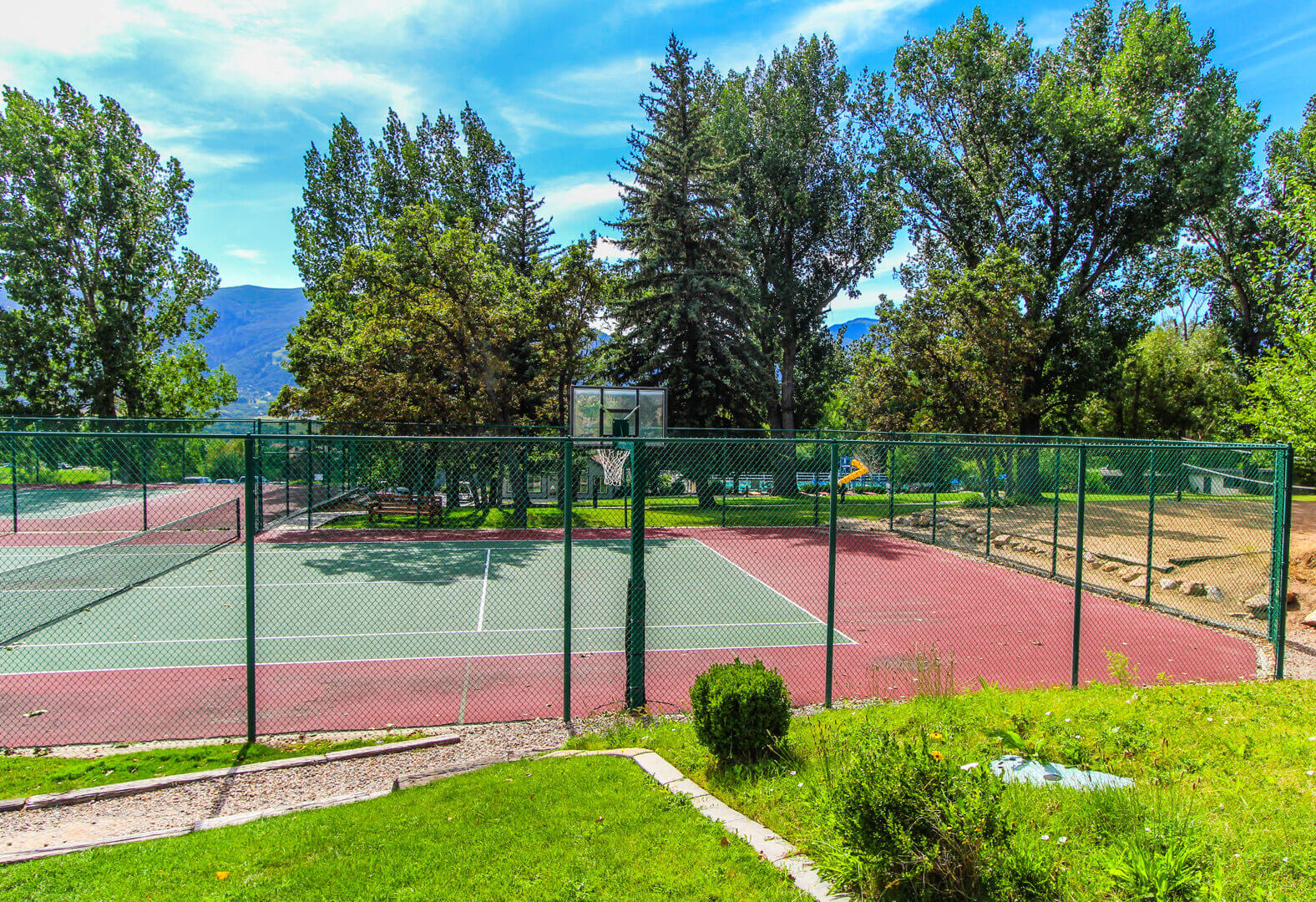 A spacious tennis and basketball court at VRI's Wolf Creek Village I in Eden, Utah.