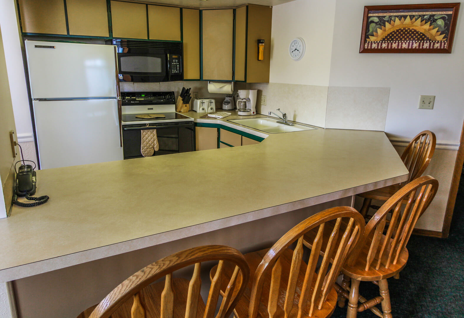 A fully equipped kitchen at VRI's Wolf Creek Village I in Eden, Utah.