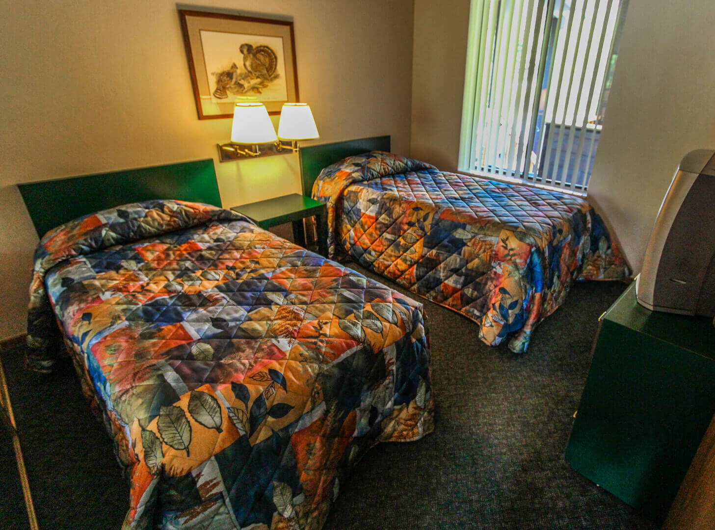 A spacious bedroom with double beds at VRI's Wolf Creek Village I in Eden, Utah.