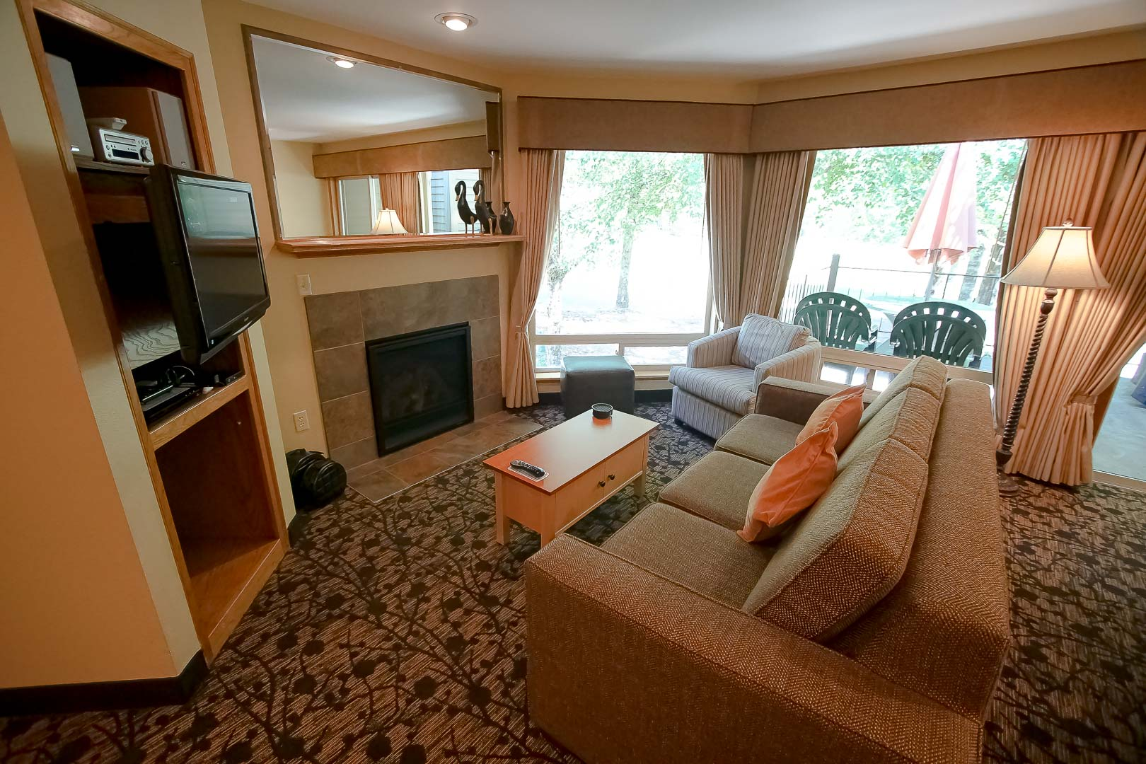 The unit's interior, living room at VRI's Whispering Woods Resort in Oregon.