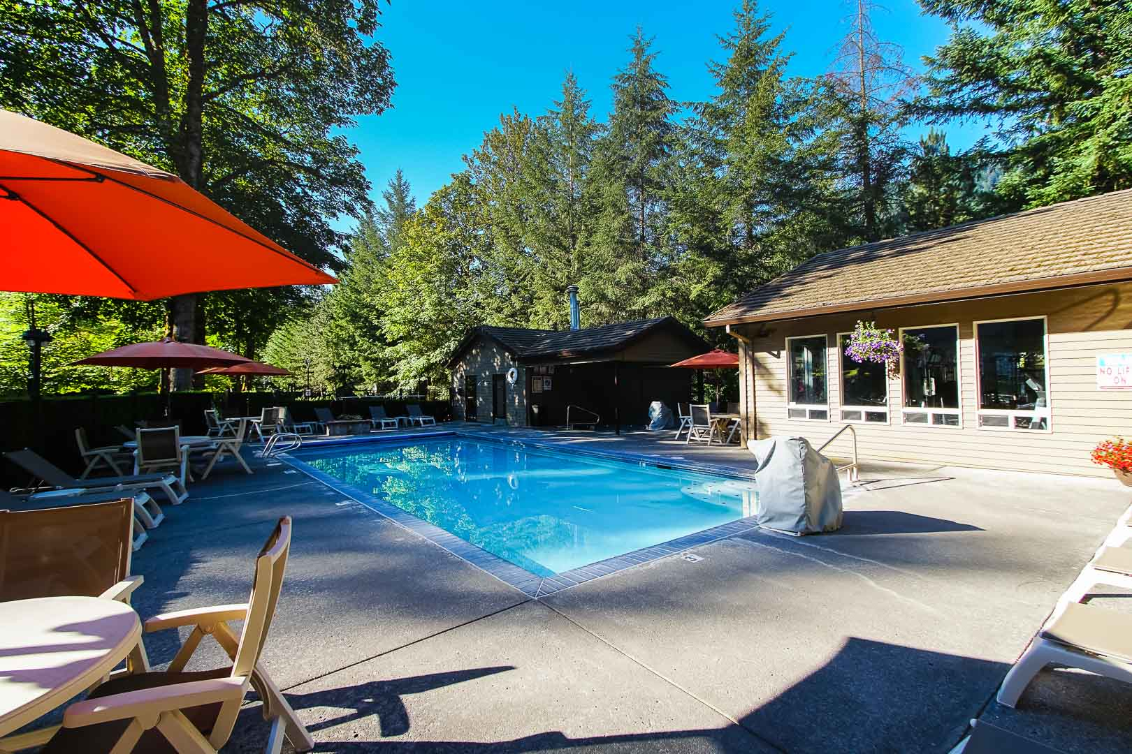 A spacious outdoor swimming pool at VRI's Whispering Woods Resort in Oregon.