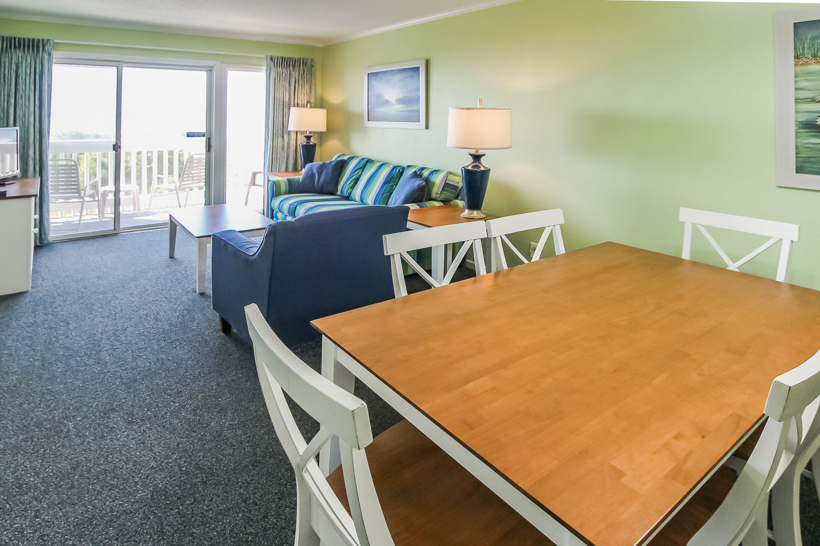 A colorful living area and dining room at VRI's A Place at the Beach III in North Carolina