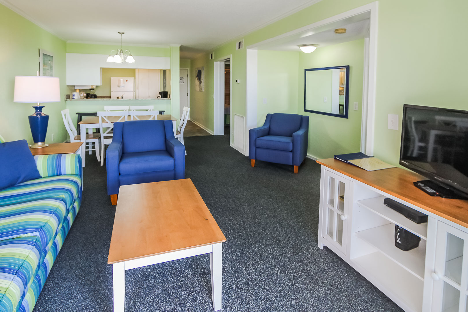 A colorful living room area at VRI's A Place at the Beach III in North Carolina