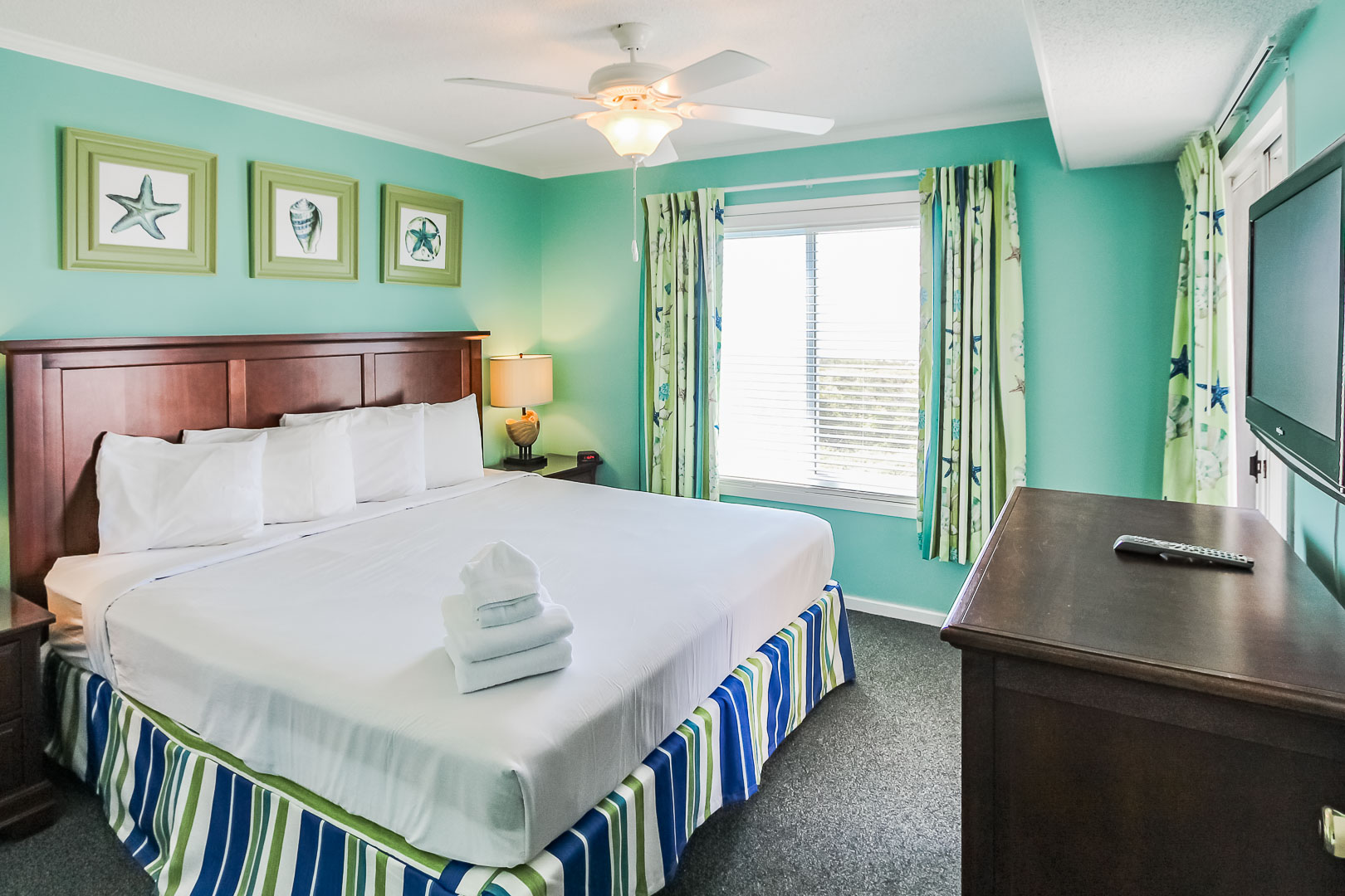 A refreshing master bedroom at VRI's A Place at the Beach III in North Carolina