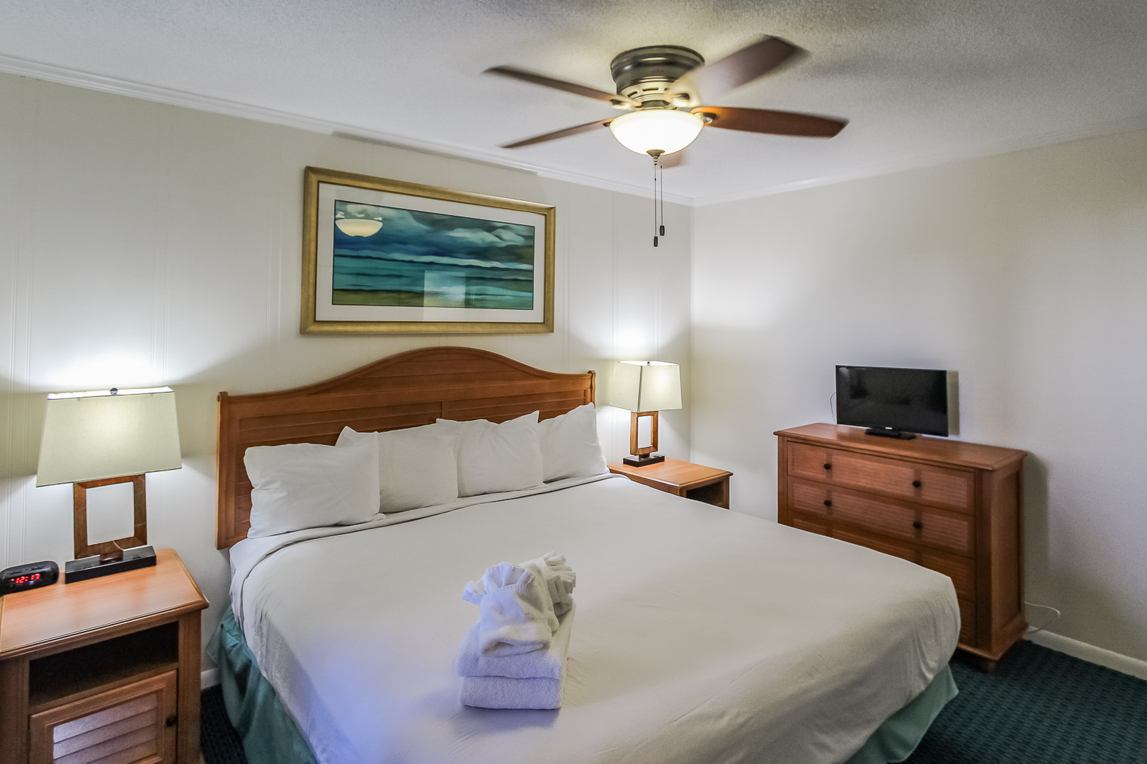 A quaint master bedroom at VRI's A Place at the Beach III in North Carolina