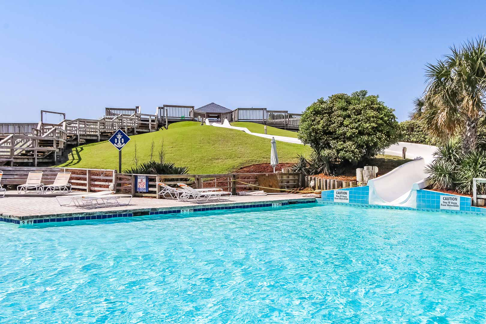 A refreshing pool with waterslide at VRI's A Place at the Beach III in North Carolina