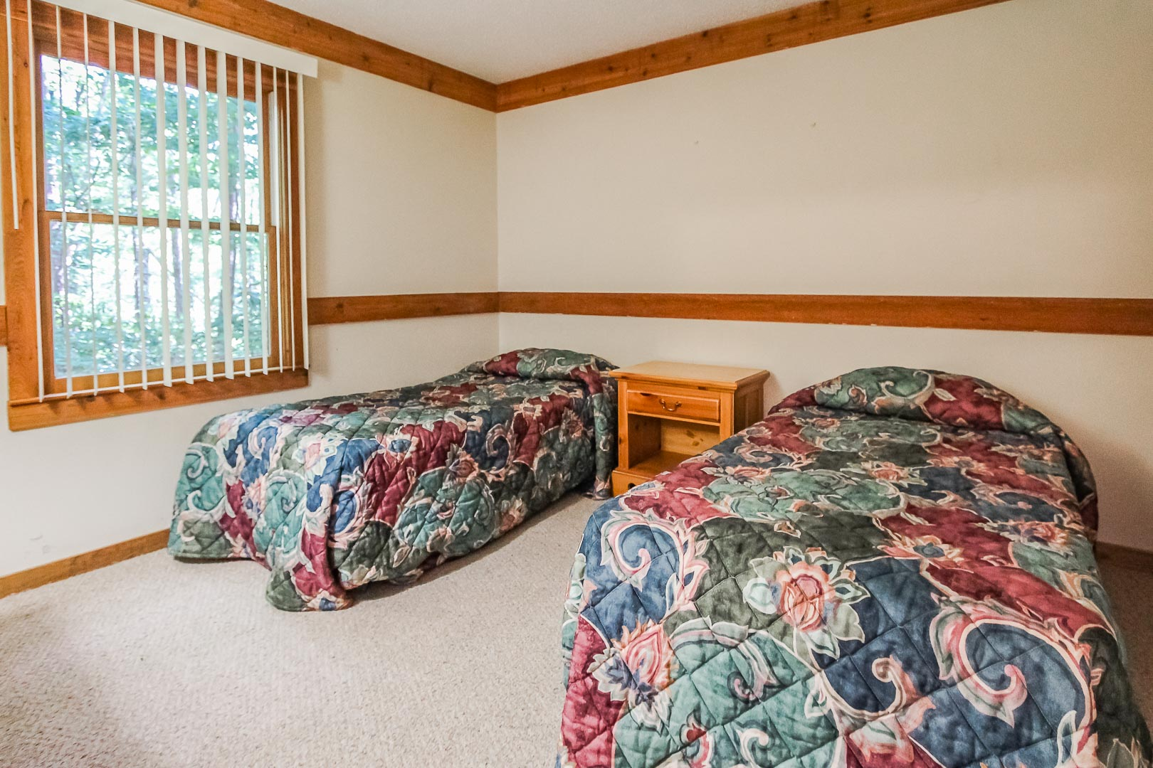 A two bedroom with double beds at VRI's Alpine Crest Resort in Georgia.
